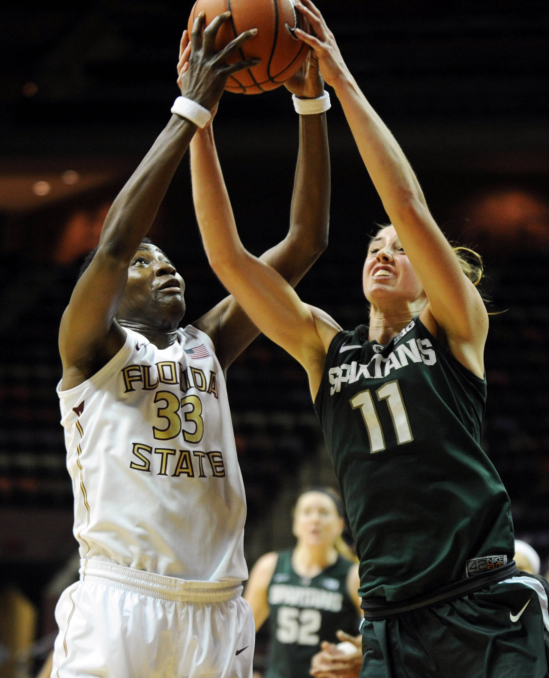 Dec 4, 2013; Tallahassee, FL, USA; Michigan State forward Annalise Pickrel (11) fights for the ball with Florida State Seminoles forward Natasha Howard (33) during the game at the Donald L. Tucker Center (Tallahassee). Mandatory Credit: Melina Vastola-USA TODAY Sports