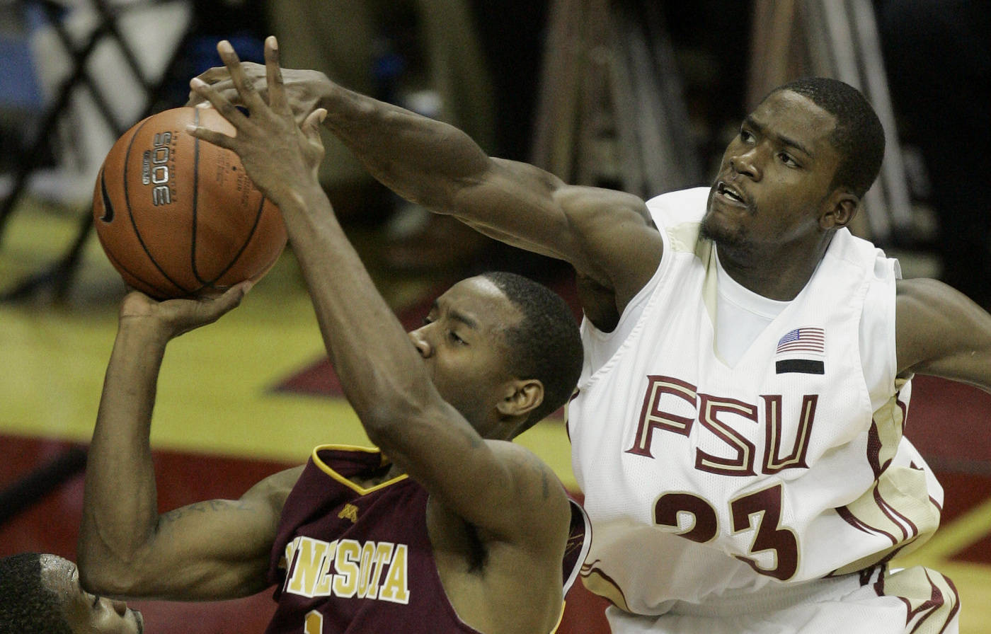 Florida State's Toney Douglas blocks a shot by Minnesota's Lawrence McKenzie during second half.