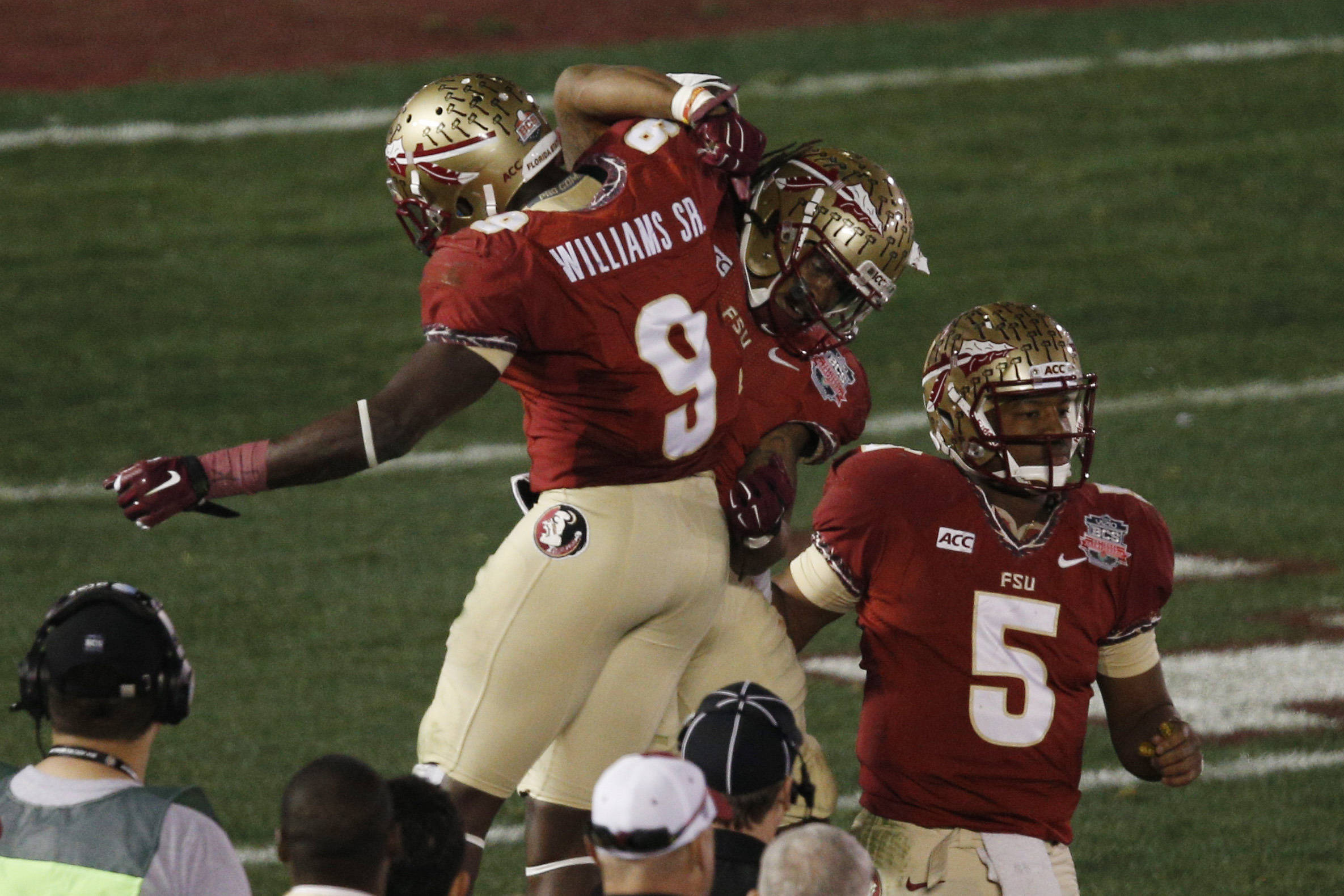Jan 6, 2014; Pasadena, CA, USA; Florida State Seminoles running back Karlos Williams (9) congratulates running back Devonta Freeman (8) in front of quarterback Jameis Winston (5) after Freeman scored a touchdown against the Auburn Tigers during the first half of the 2014 BCS National Championship game at the Rose Bowl.  Mandatory Credit: Kelvin Kuo-USA TODAY Sports