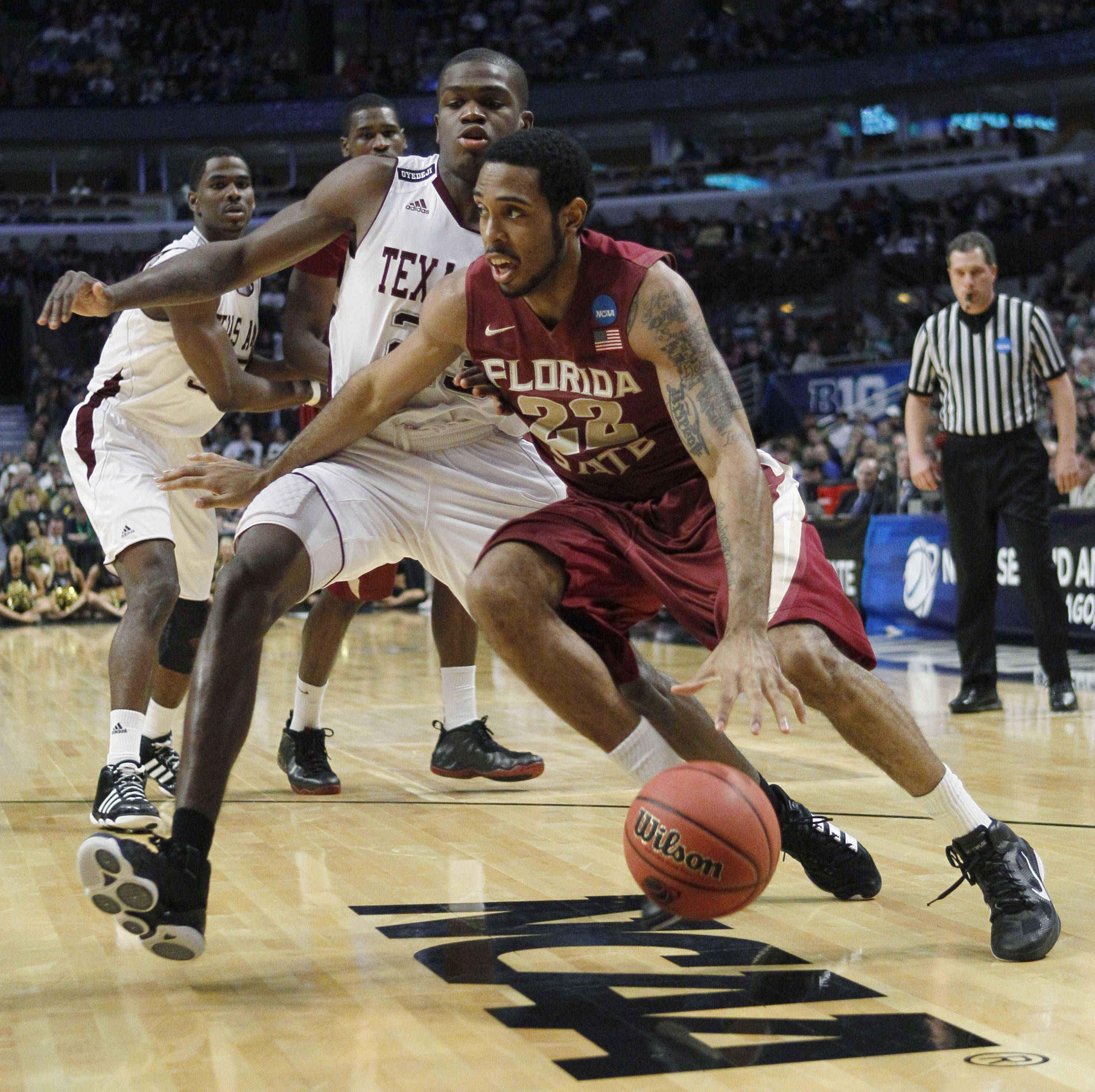 Florida State's Derwin Kitchen drives around Texas A&M's Naji Hibbert. (AP Photo/Charles Rex Arbogast)