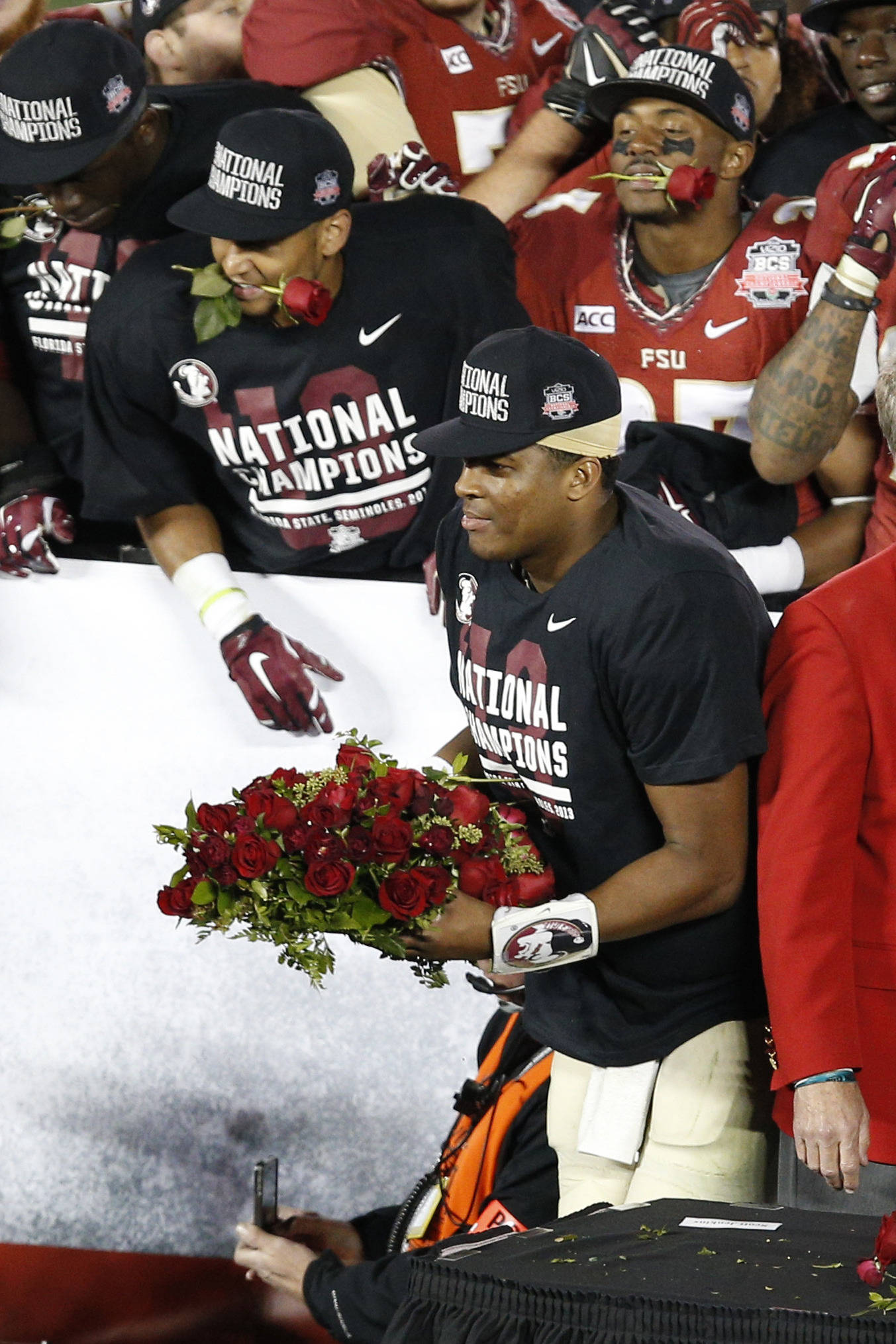 Jan 6, 2014; Pasadena, CA, USA; Florida State Seminoles quarterback Jameis Winston (5) carries roses after defeating the Auburn Tigers 34-31 in the 2014 BCS National Championship game at the Rose Bowl.  Mandatory Credit: Kelvin Kuo-USA TODAY Sports