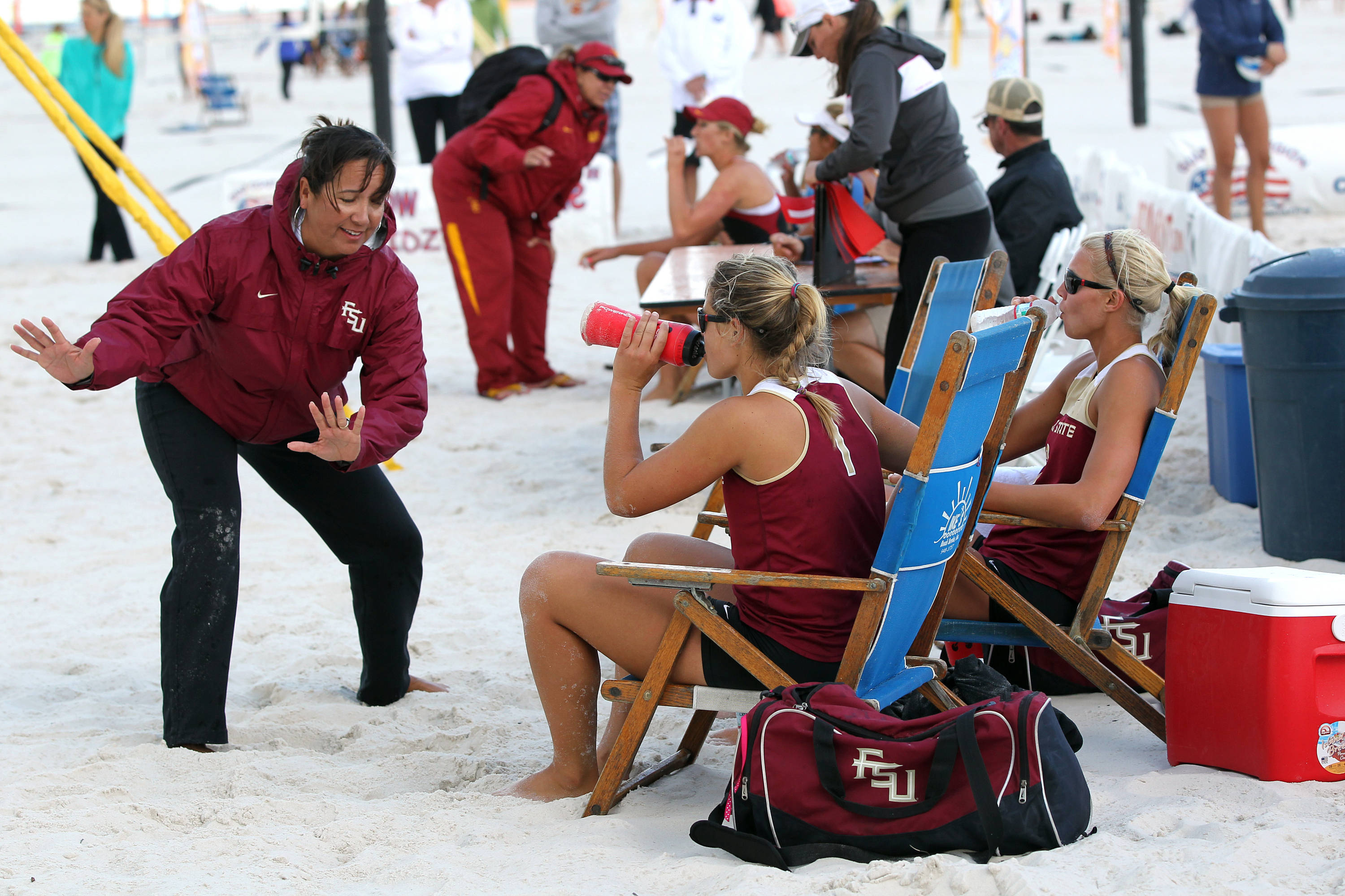 Head Coach Danalee Corso with demonstrating instructions to Melanie Pavels and Julie Brown, AVCA Collegiate Sand Volleyball National  Championships - Pairs,  Gulf Shores, Alabama, 05/05/13 . (Photo by Steve Musco)