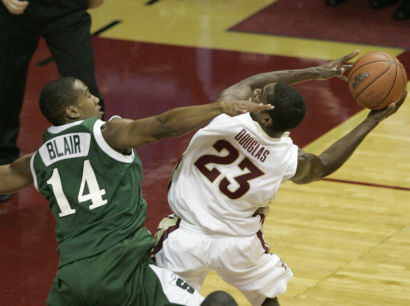 Florida State's Toney Douglas, right, is fouled by Stetson's Garfield Blair as he drives to the basket in the first half of a college basketball game on Friday Nov. 30, 2007 in Tallahassee, Fla. (AP Photo/Steve Cannon)