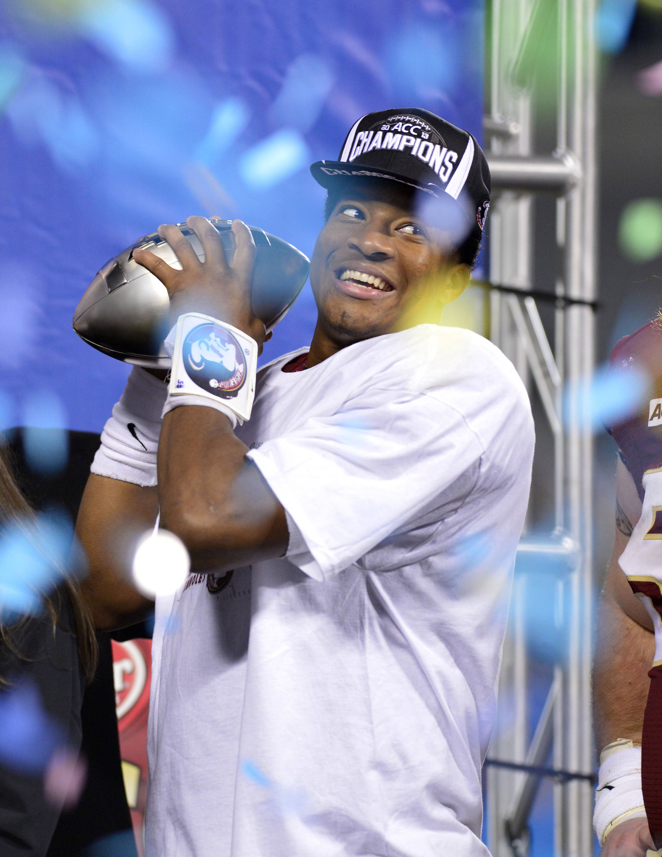 Florida State Seminoles quarterback Jameis Winston (5) pretends to pass the ACC Championship trophy. The Seminoles defeated the Blue Devils 45-7 at Bank of America Stadium. Credit: Bob Donnan-USA TODAY Sports