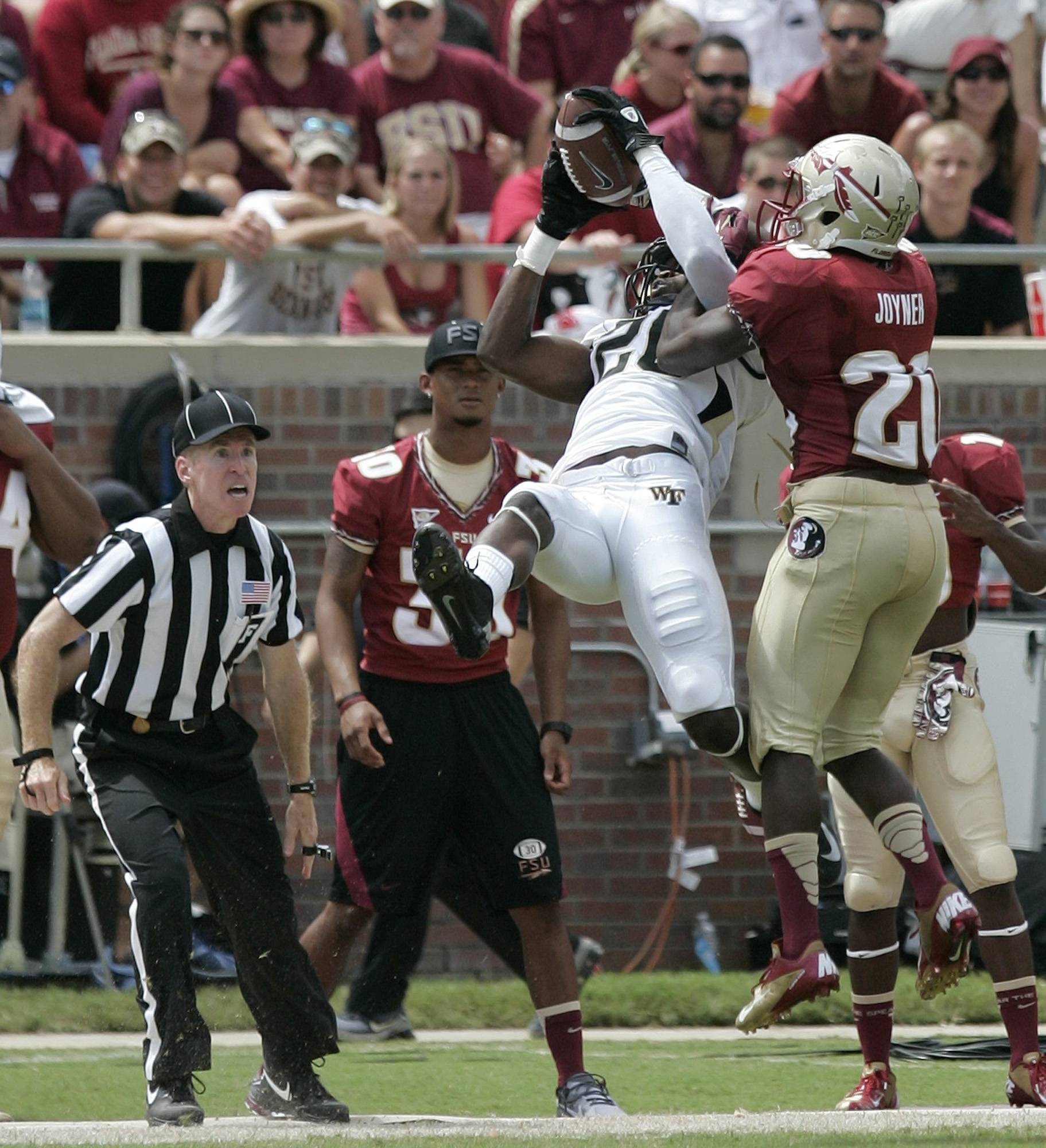 Wake Forest's Sherman Ragland catches a pass for 41 yards despite the defense of Florida State's Lamarcus Joyner. (AP Photo/Steve Cannon)