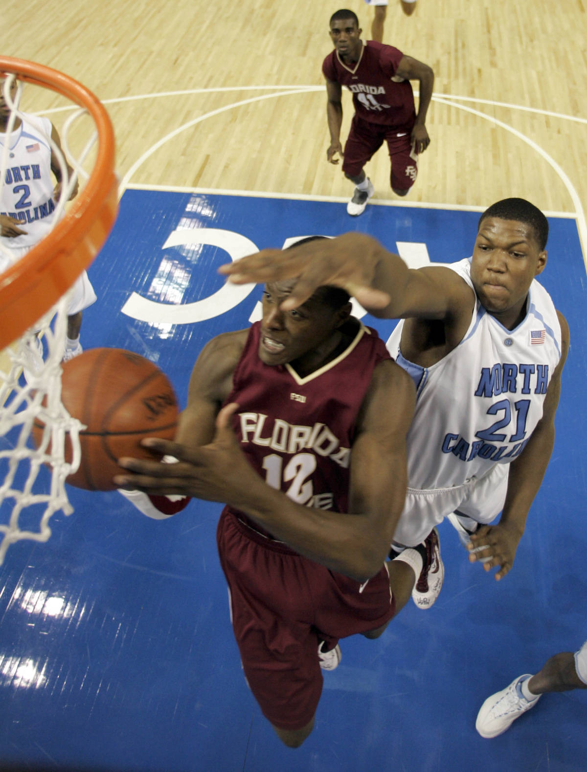 North Carolina's Deon Thompson (21) reaches to block a shot by Florida State's Al Thornton (12) during a second round game of the Men's Atlantic Coast Conference basketball tournament in Tampa, Fla., Friday, March 9, 2007. (AP Photo/David J. Phillip)