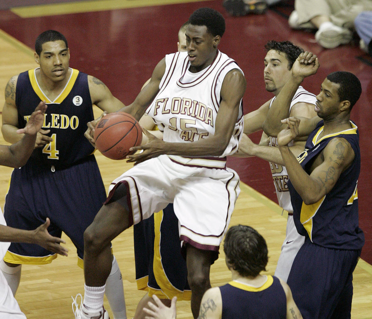 Florida State's Casaan Breeden comes down with an offensive rebound surrounded by Toledo players. (AP Photo/Steve Cannon)