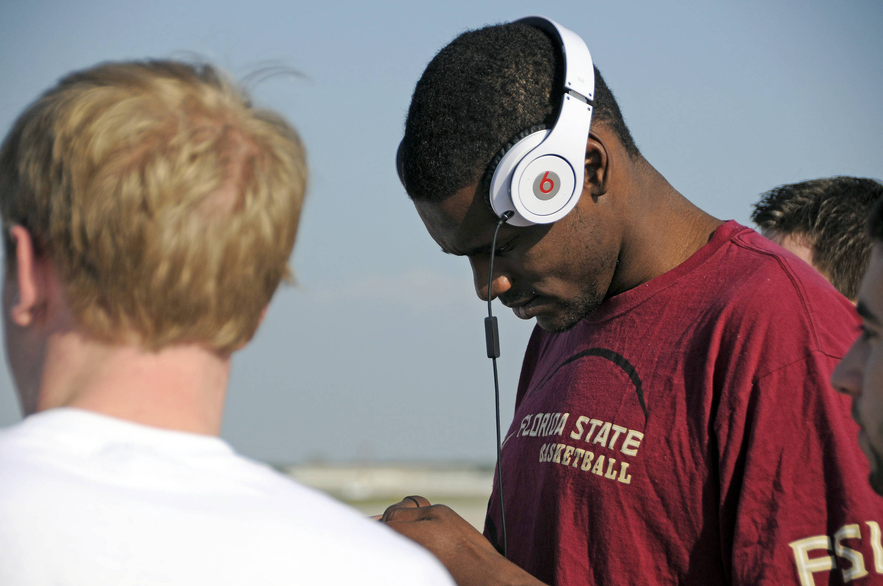 Bernard James checks his phone for messages after arriving in San Antonio