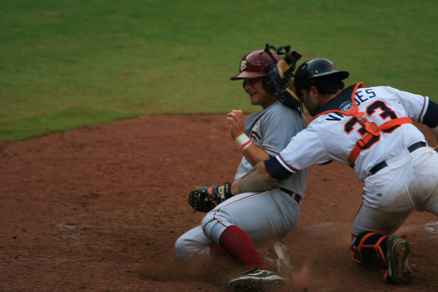 Tommy Oravetz slides in at home but was sent back to third after advancing on a dead ball play.