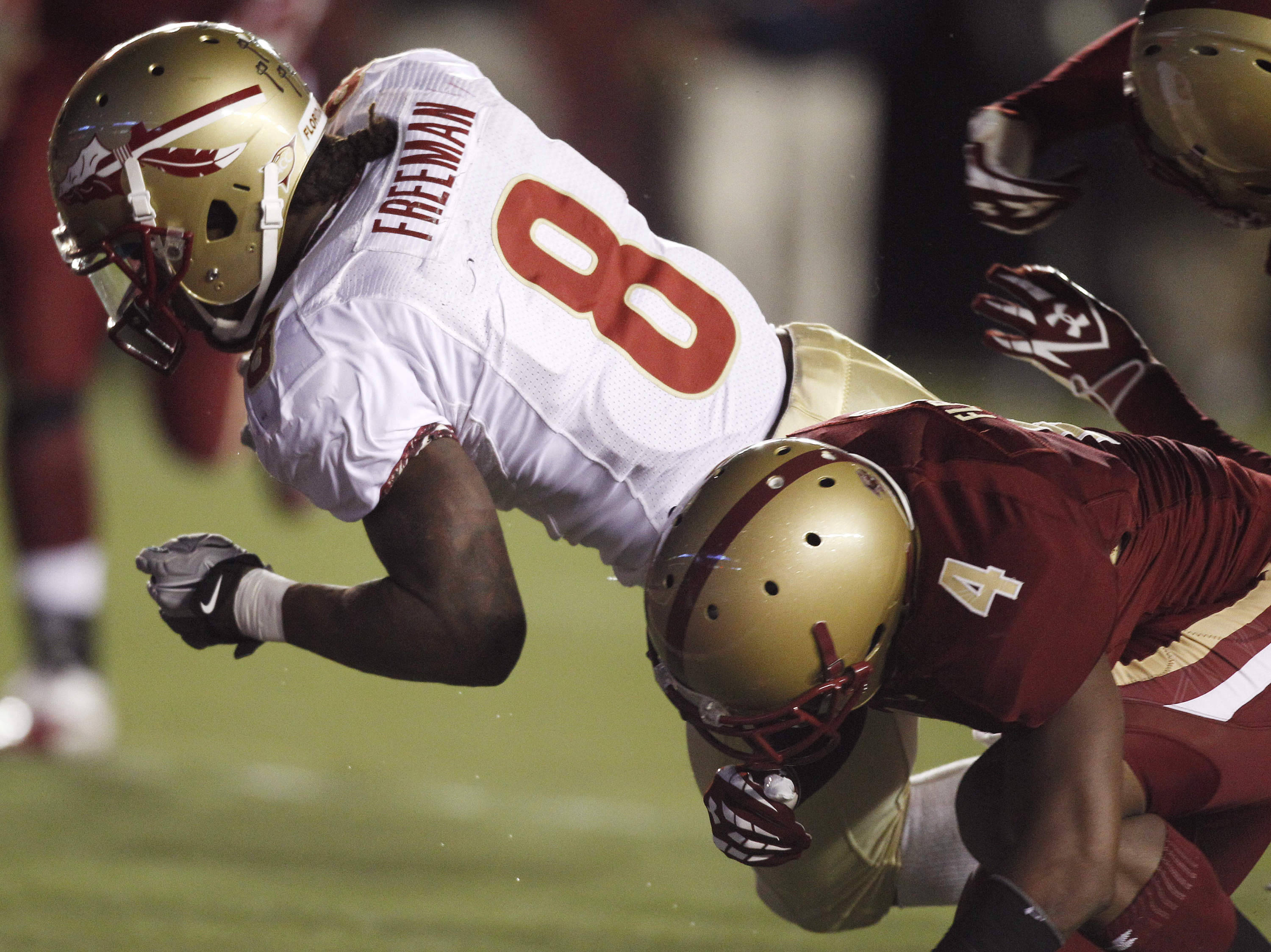 Florida State running back Devonta Freeman (8) gets past Boston College cornerback Donnie Fletcher (4) as he crosses the goal line for a touchdown during the first half. (AP Photo/Charles Krupa)