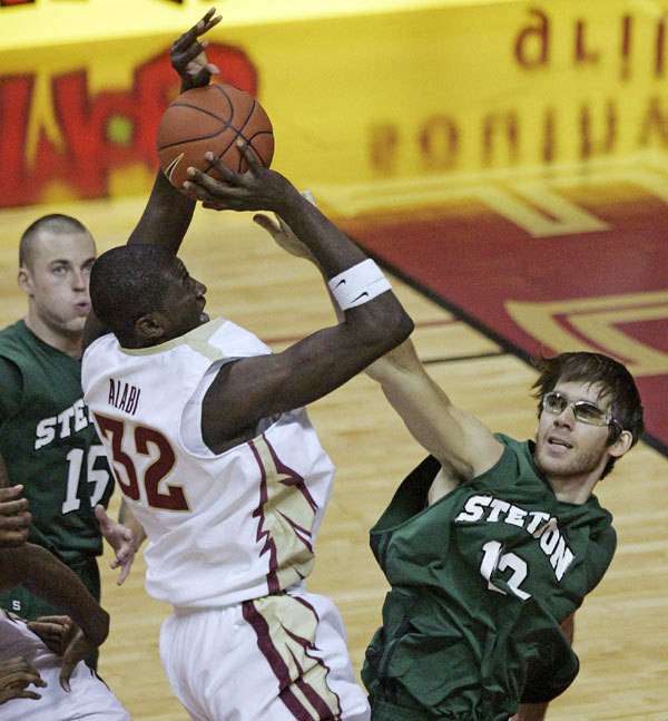 Florida State's Solomon Alabi is fouled by Stetson's Graeme Radford during the first half.