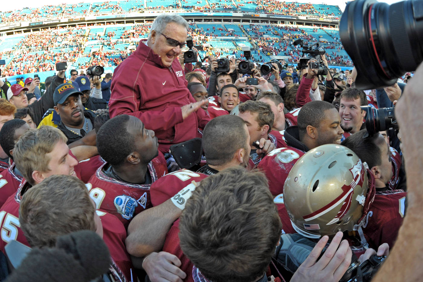 Players carry Bowden off the field