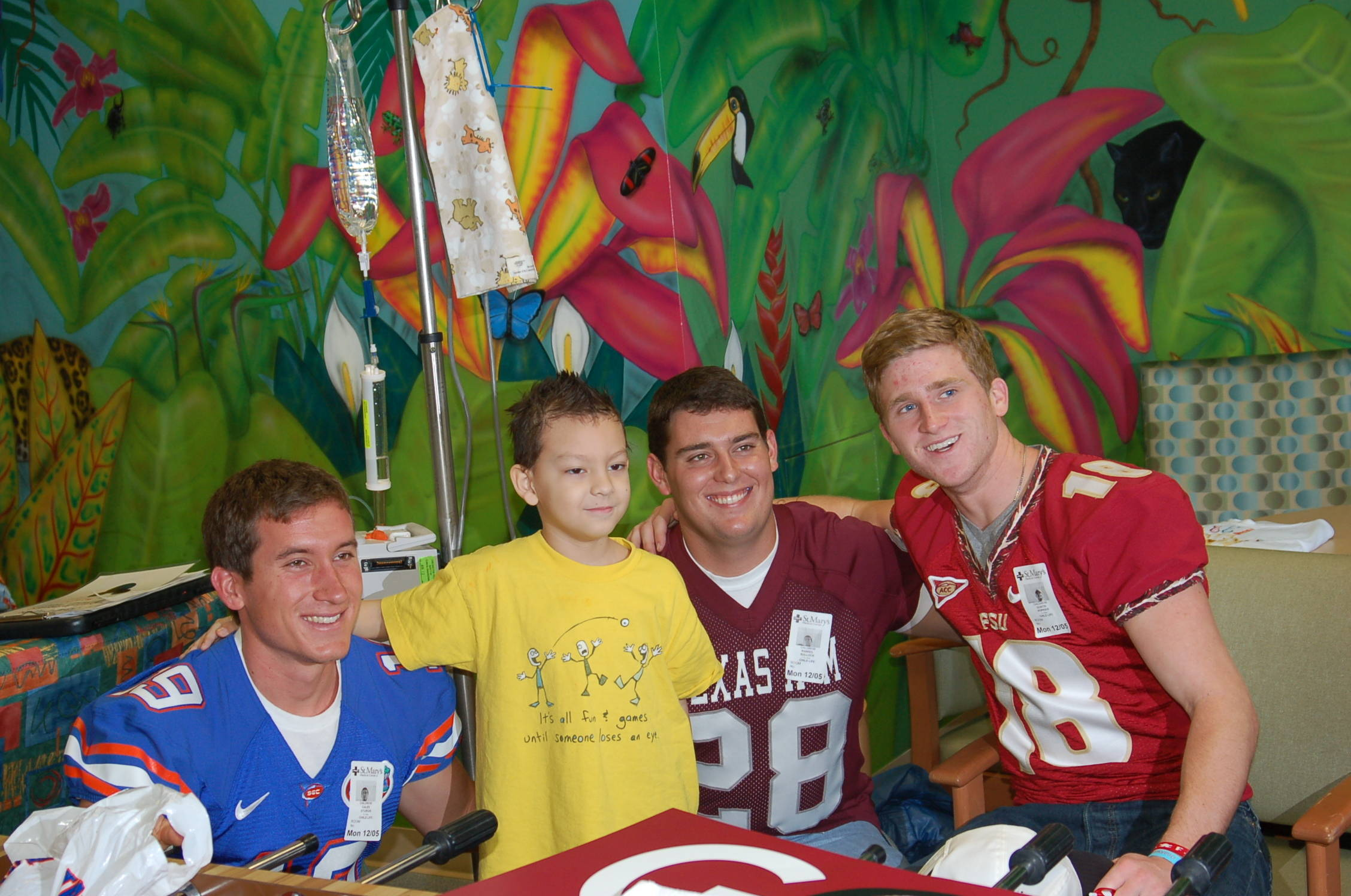 The players seemed to enjoy the Children's Hospital visit as much as the youngsters.