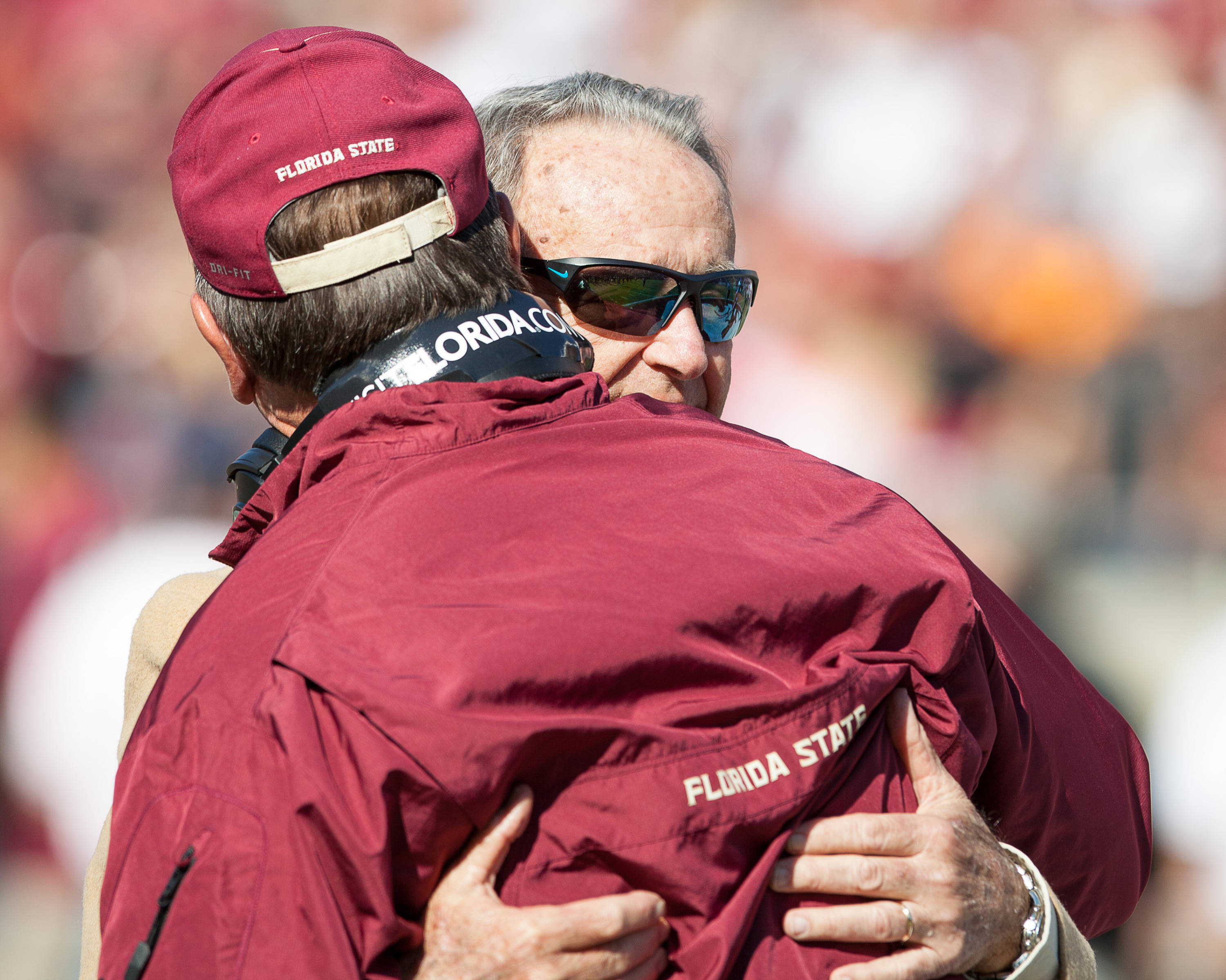 Bobby Bowden hugs Jimbo Fisher before FSU Football's 49-17 win over NC State on Saturday, October 26, 2013 in Tallahassee, Fla. Photo by Michael Schwarz.