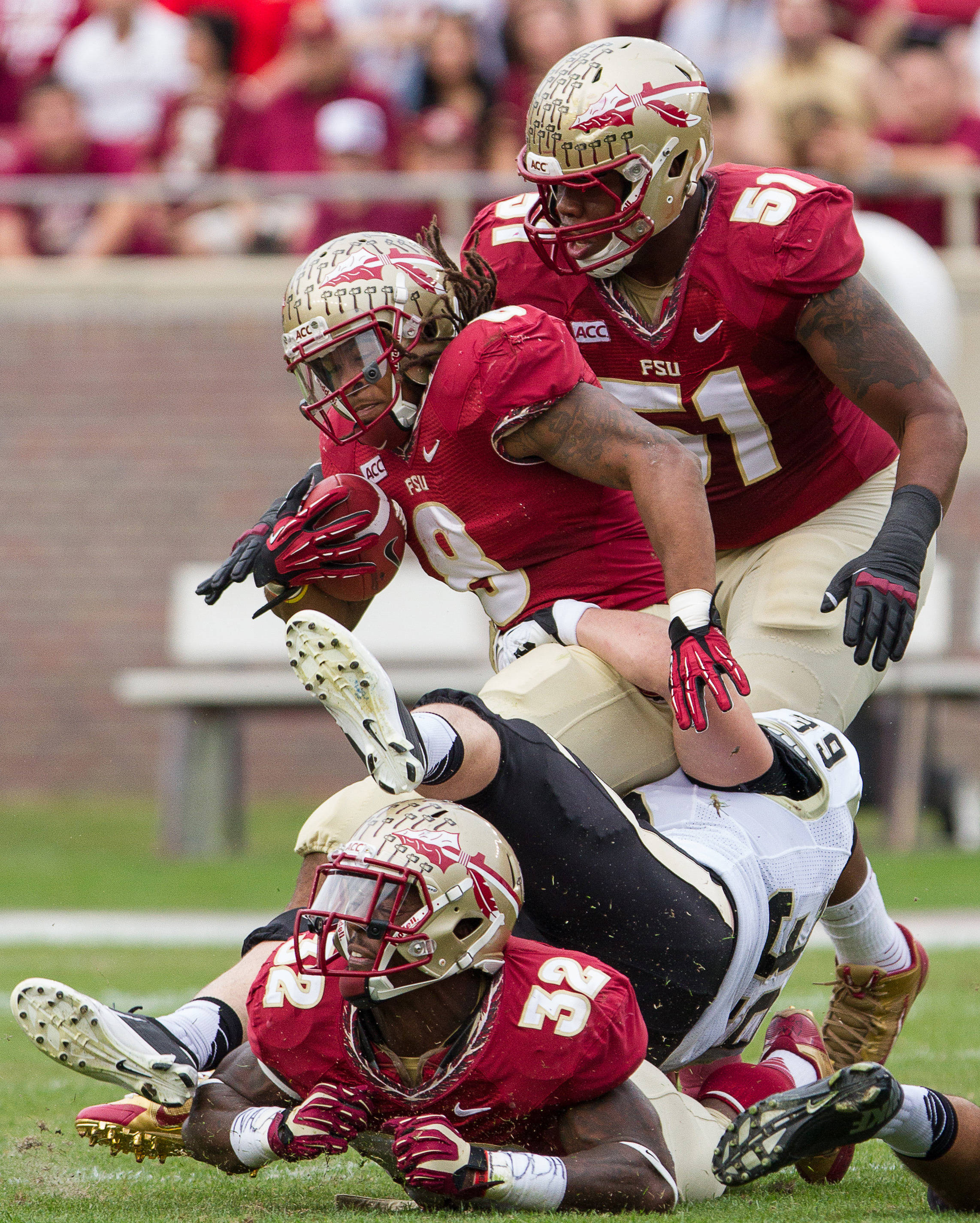 Devonta Freeman (8) is tackled during FSU Football's 80-14 victory over Idaho in Tallahassee, Fla on Saturday, November 23, 2013. Photos by Mike Schwarz.