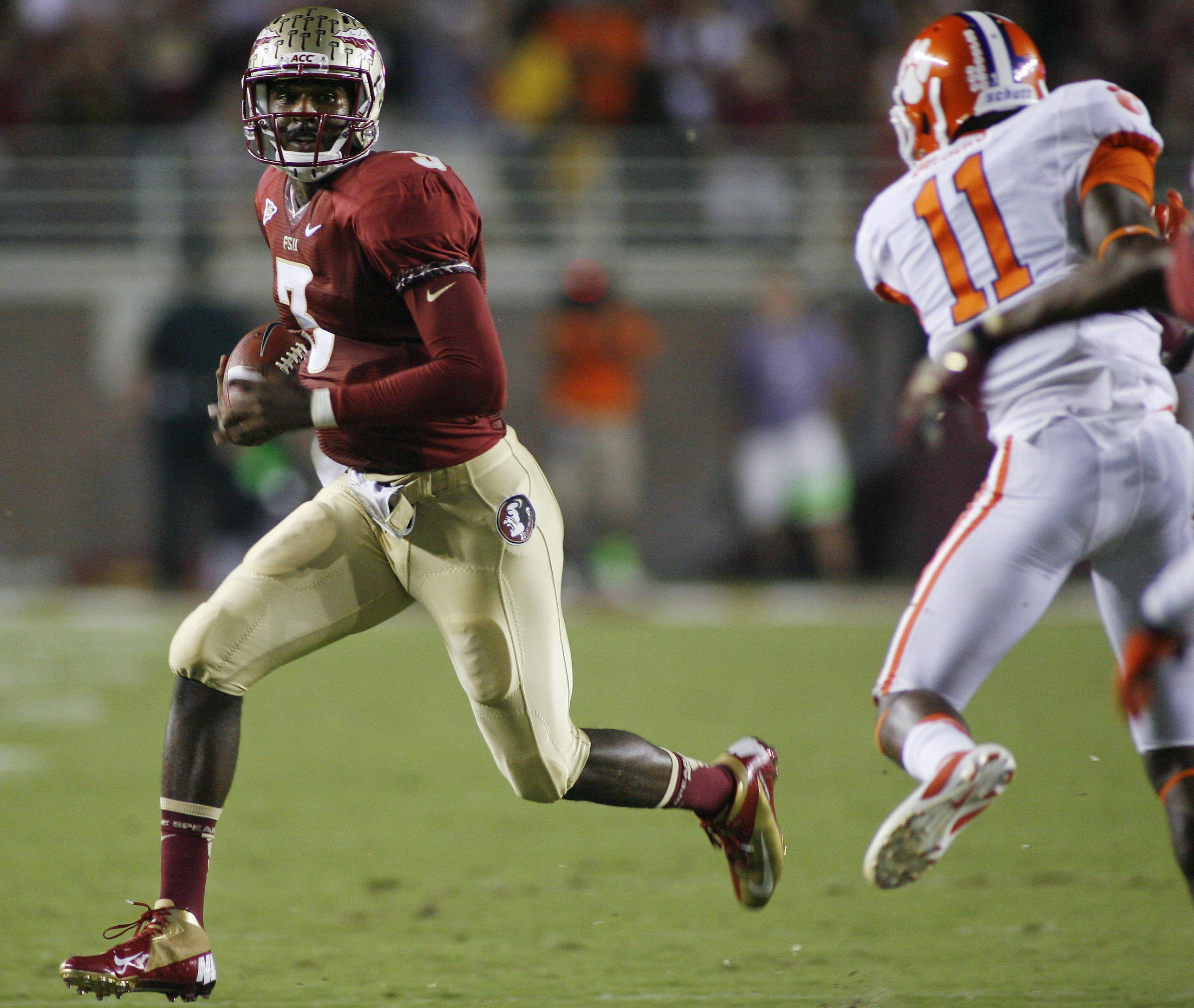 Florida State quarterback E.J. Manuel (3) runs by Clemson safety Travis Blanks (11) for a 28-yard gain. (AP Photo/Phil Sears)