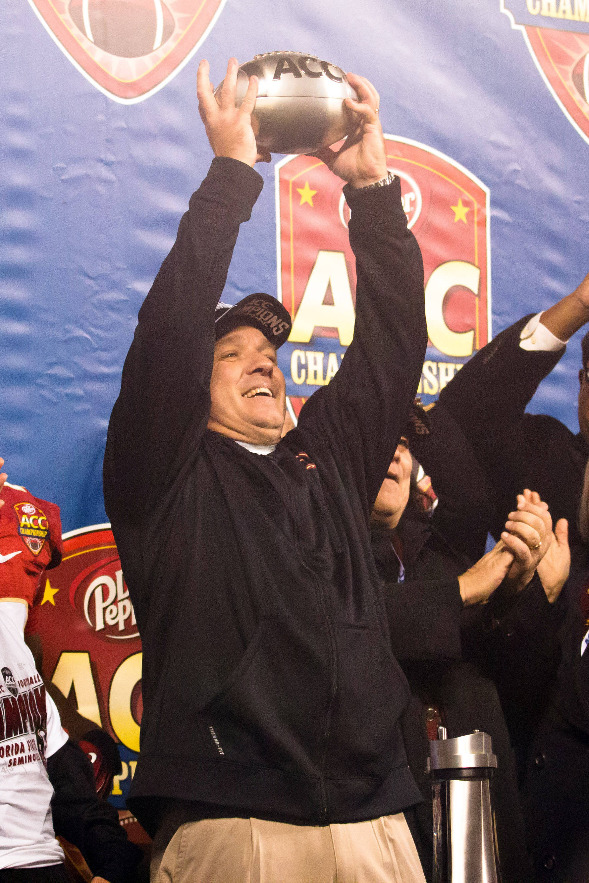 Dec 7, 2013; Charlotte, NC, USA; Florida State Seminoles head coach Jimbo Fisher holds up part of the ACC trophy after defeating the Duke Blue Devils at Bank of America Stadium. FSU defeated Duke 45-7. Mandatory Credit: Jeremy Brevard-USA TODAY Sports