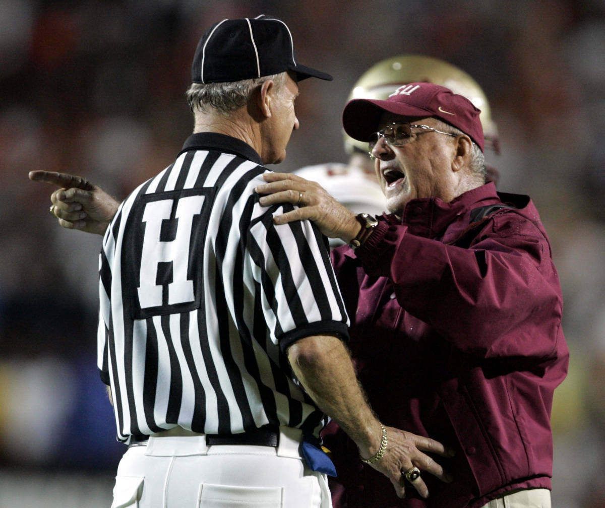 Florida State head coach Bobby Bowden, right, argues with head linesman Mike Samples during the third quarter of football against Miami Monday, Sept. 4, 2006 at the Orange Bowl in Miami. Florida St. defeated Miami 13-10. (AP Photo/Lynne Sladky)
