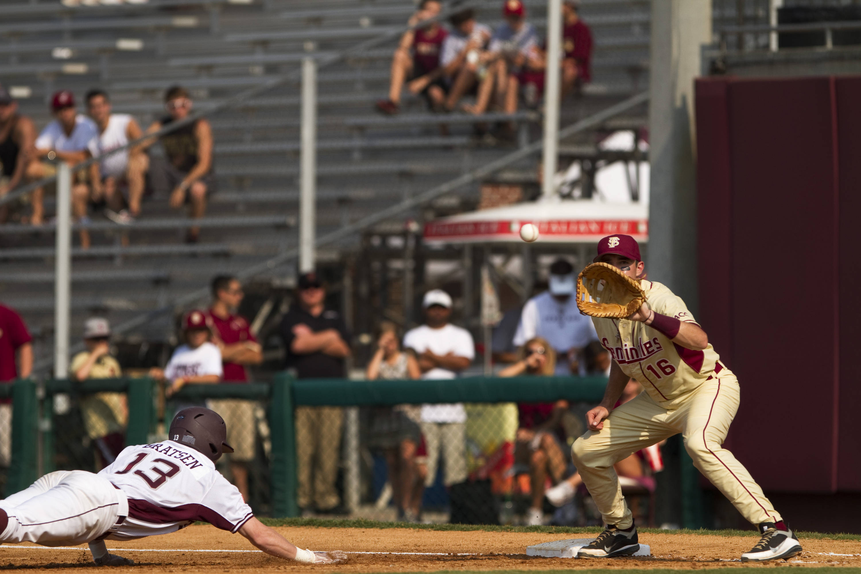 Jayce Boyd (16) attempts to tag out a runner.