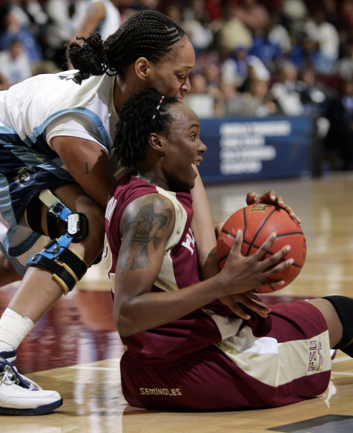 Florida State guard Alysha Harvin, right, and Old Dominion forward Tamara Ransberg battle for a loose ball in the first half of a first-round game of the West Regional of the NCAA women's basketball tournament, Saturday, March 17, 2007, in Stanford, Calif. (AP Photo/Paul Sakuma)