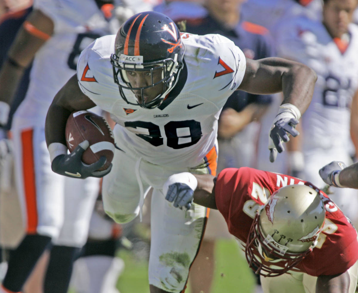 Virginia running back Jason Snelling, left, is tackled by Florida State's Michael Ray Garvin in the second quarter of a college football game, Saturday, Nov. 4, 2006, in Tallahassee, Fla. (AP Photo/Phil Coale)