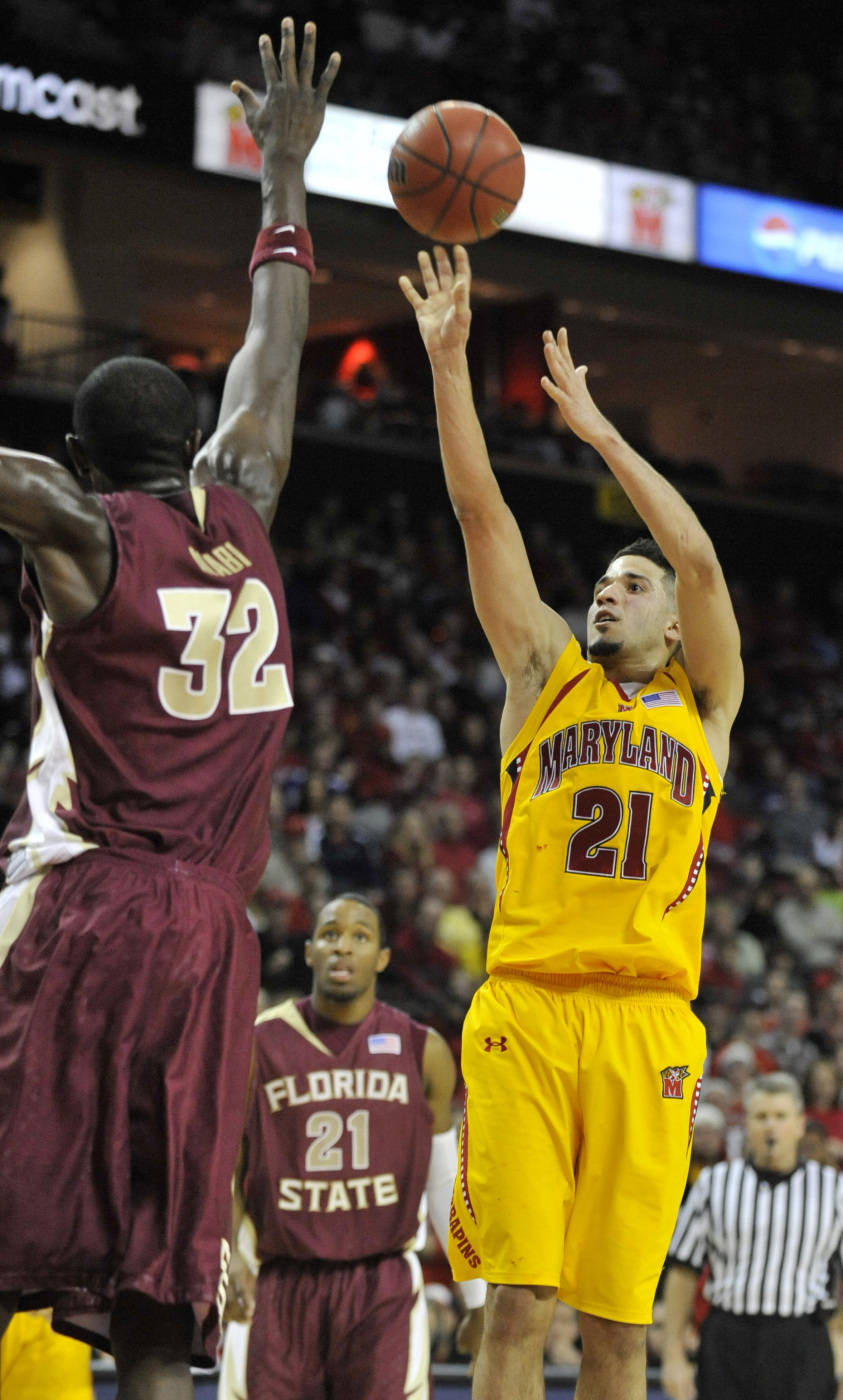 Maryland's Greivis Vasquez shoots as Florida State's Solomon Alabi tries to block in the second half of an NCAA college basketball game Sunday, Jan. 10, 2010, in College Park, Md. Maryland won 77-68. (AP Photo/Gail Burton)