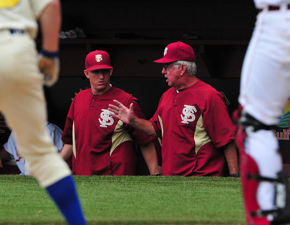 Associate head coach Mike Bell and head coach Mike Martin in the Seminole dugout.