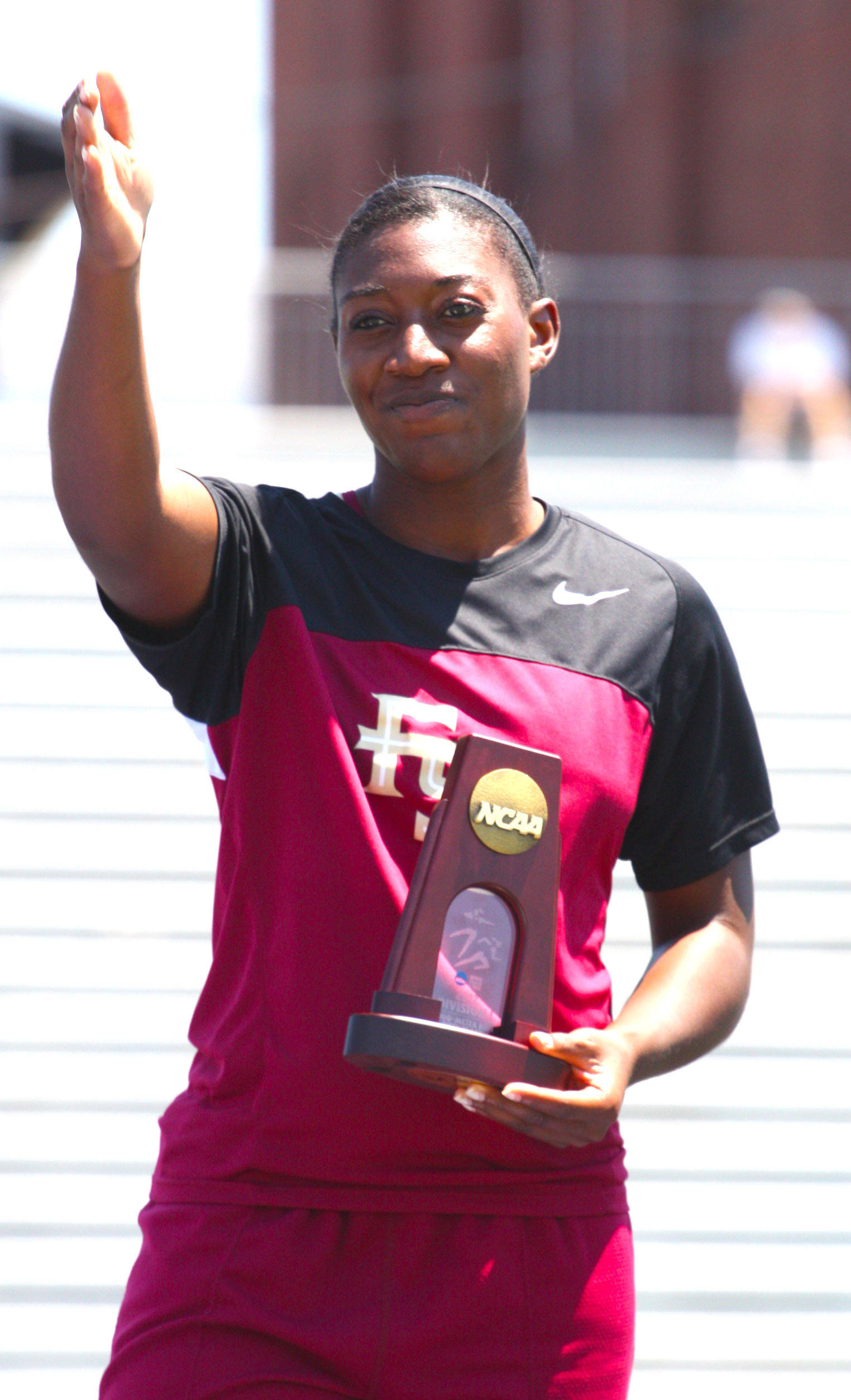 Michelle Jenije celebrates her fifth-place NCAA finish in the triple jump
