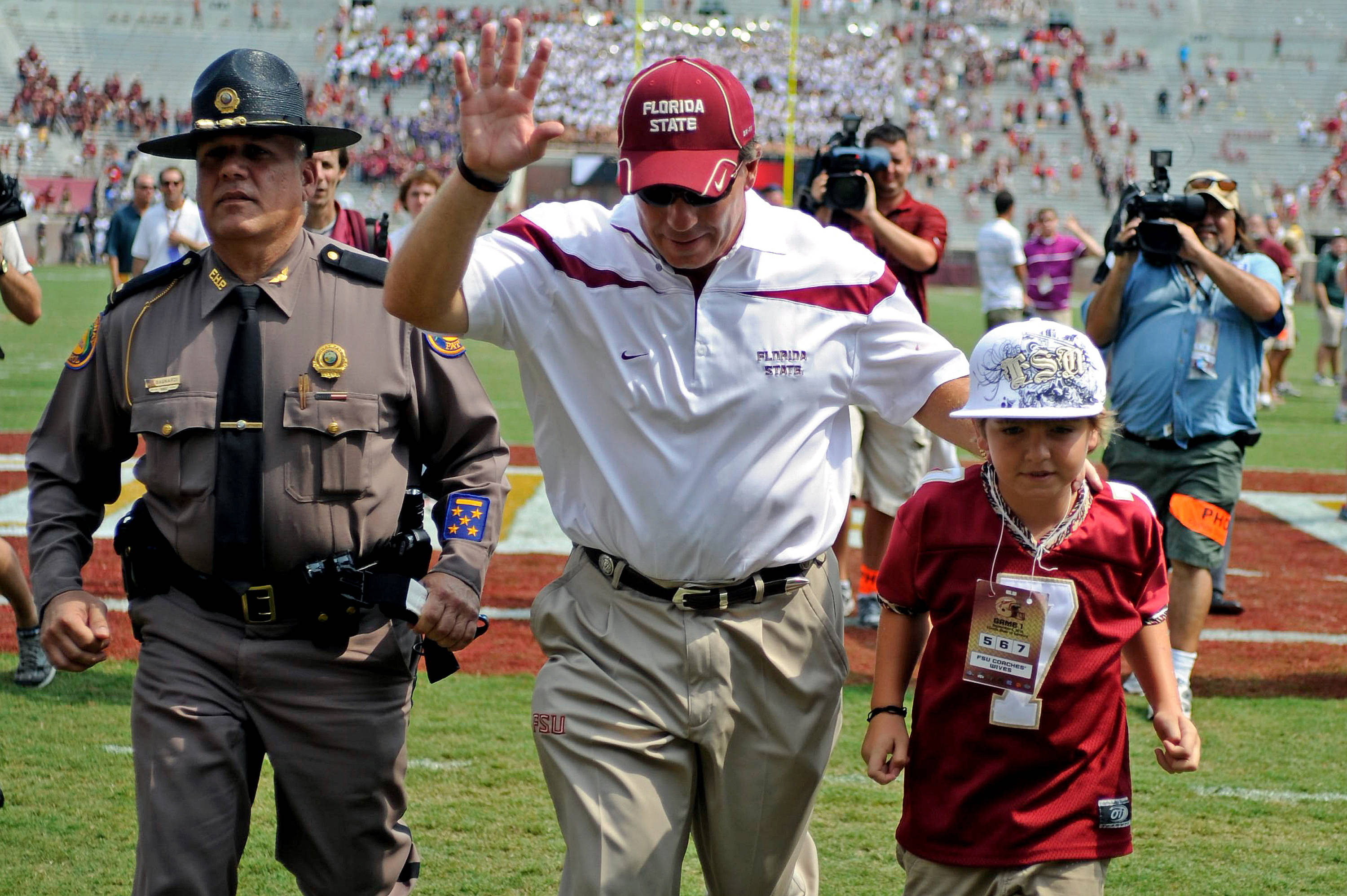 Jimbo Fisher walks off the field with his son Trey