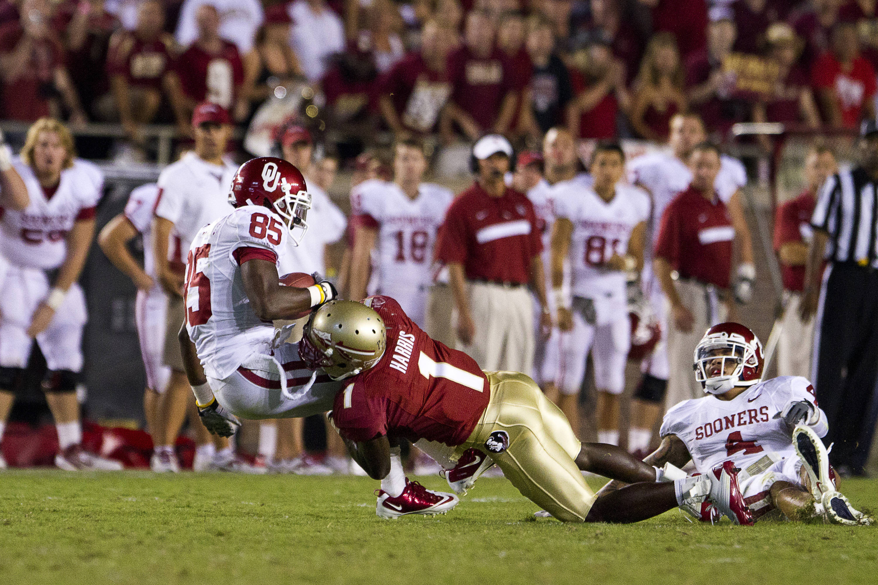 Mike Harris (1) makes an excellent tackle on Oklahoma's Ryan Broyles on September 17th