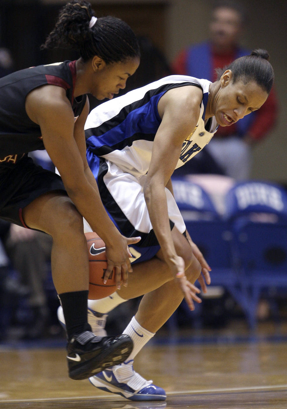 Florida State's Angel Gray and Duke's Jasmine Thomas battle for the ball.