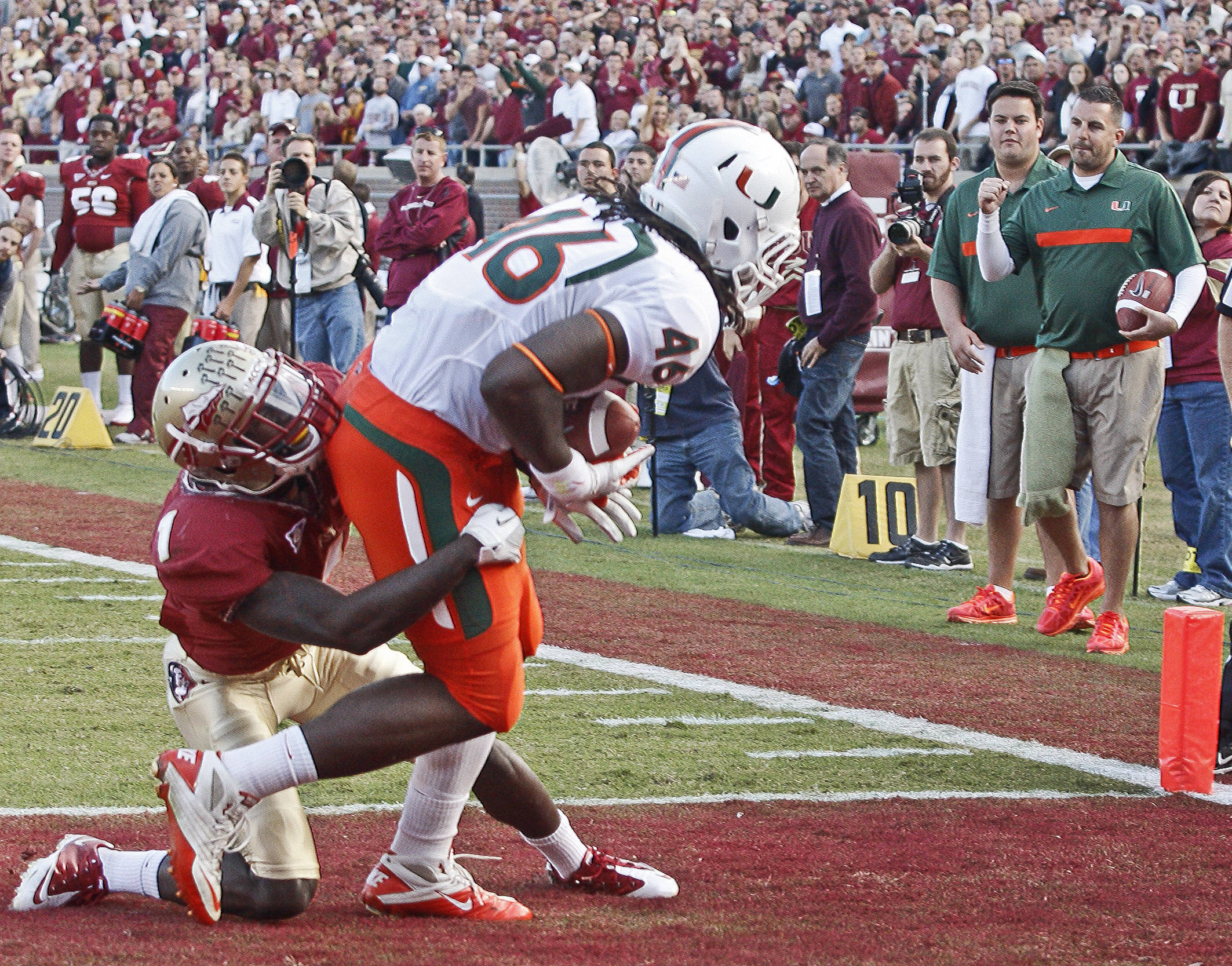 Florida State cornerback Mike Harris (1) can't stop Miami tight end Clive Walford (46) from scoring on a 2-yard touchdown pass during the second quarter of an NCAA college football game on Saturday, Nov. 12, 2011, in Tallahassee, Fla. (AP Photo/Phil Sears)