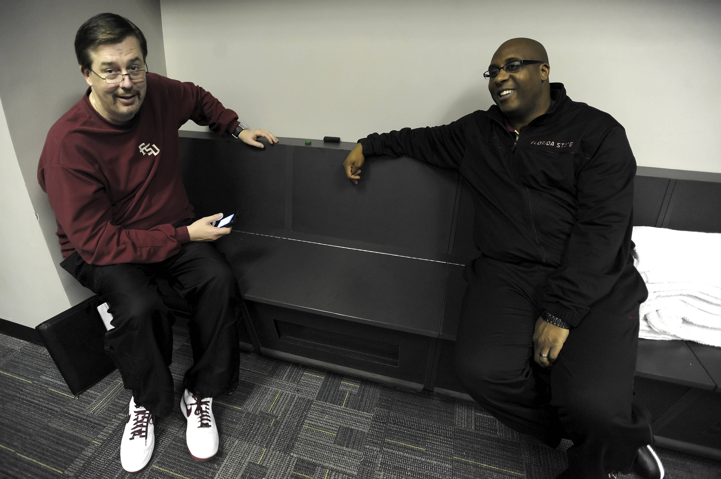 Associate head coach Stan Jones and assistant coach Corey Williams in the FSU locker room before practice.