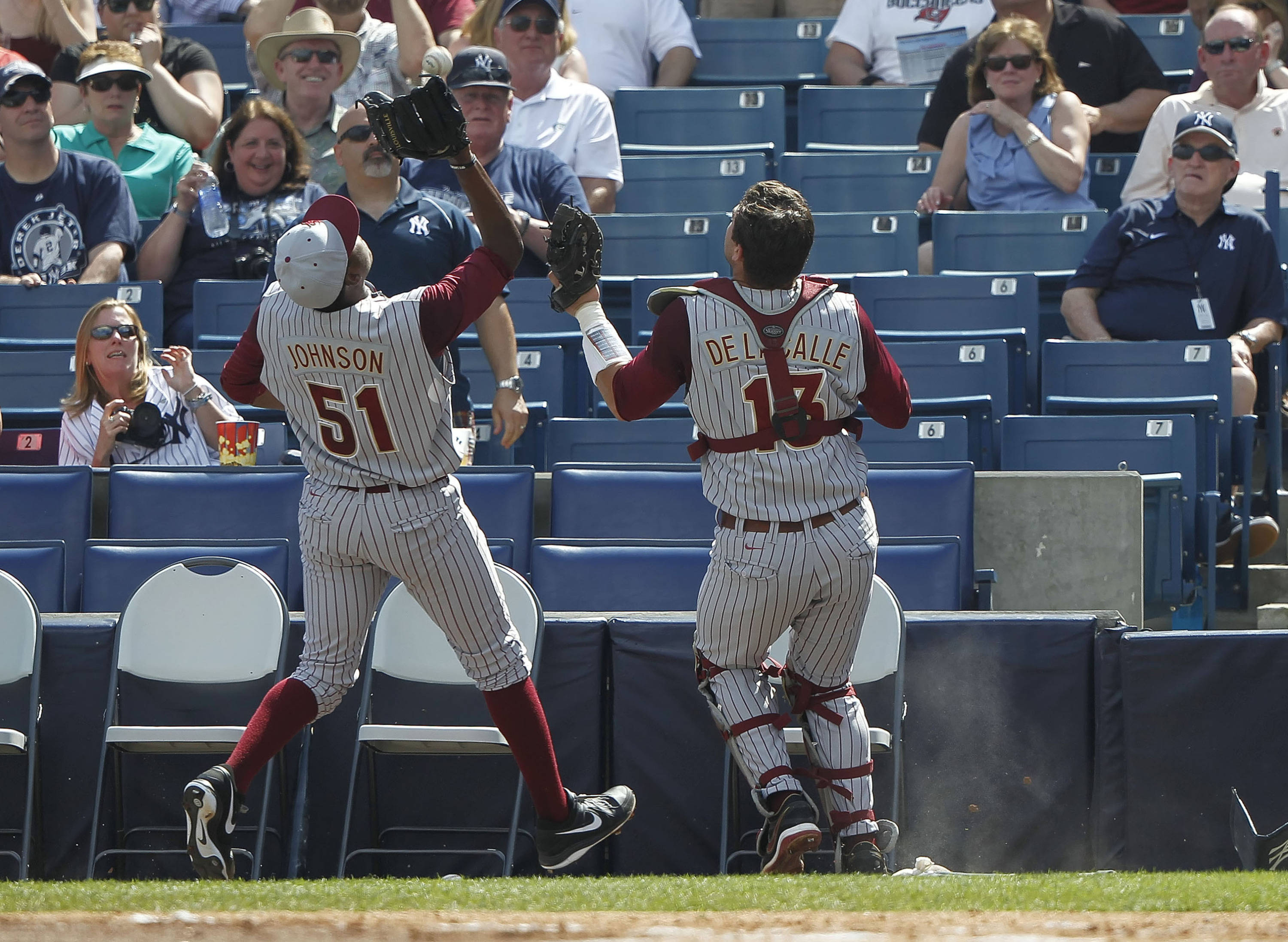 Feb 25, 2014; Tampa, FL, USA;  Florida State Seminoles pitcher Brandon Johnson (51) catches a foul ball for an out as catcher Danny De La Calle looks on during the third inning against the New York Yankees at George M. Steinbrenner Field. Mandatory Credit: Kim Klement-USA TODAY Sports
