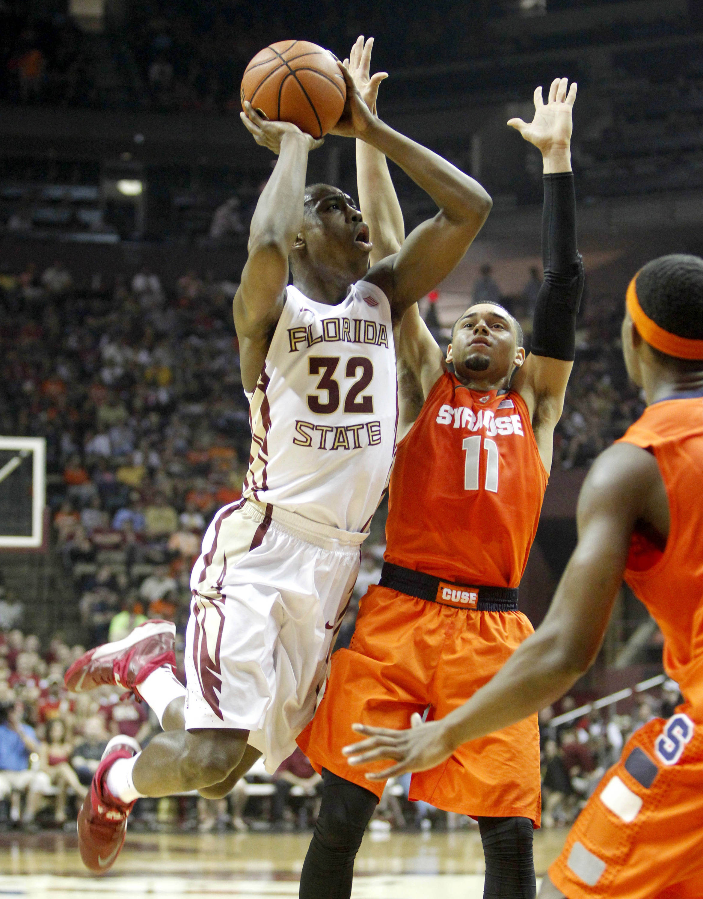Mar 9, 2014; Tallahassee, FL, USA; Florida State Seminoles guard Montay Brandon (32) takes a shot around Syracuse Orange guard Tyler Ennis (11) during the first half at Donald L. Tucker Center. Mandatory Credit: Matt Stamey-USA TODAY Sports