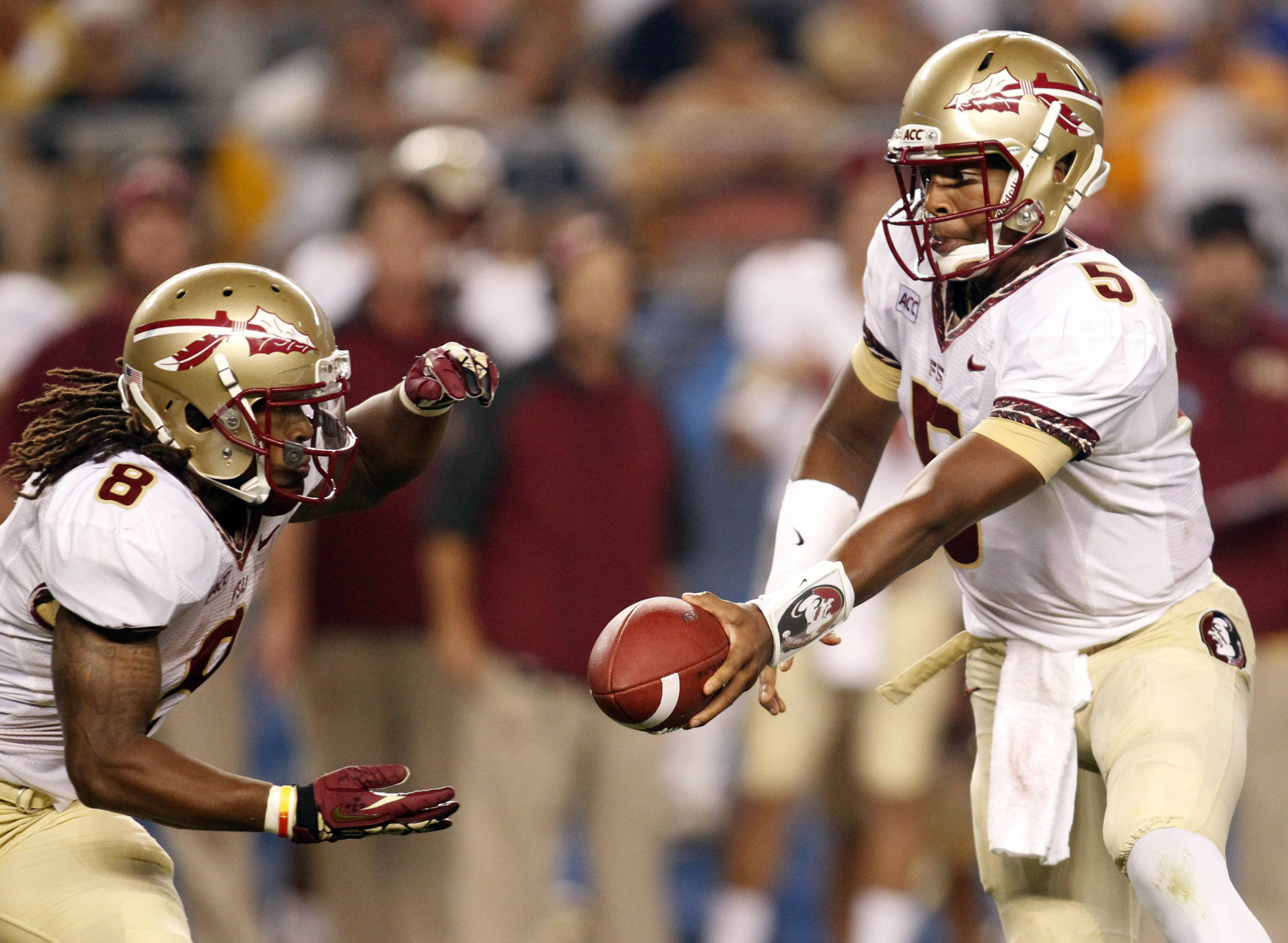 Florida State Seminoles quarterback Jameis Winston (5) hands off to running back Devonta Freeman (8) against the Pittsburgh Panthers during the second quarter at Heinz Field. Mandatory Credit: Charles LeClaire-USA TODAY Sports