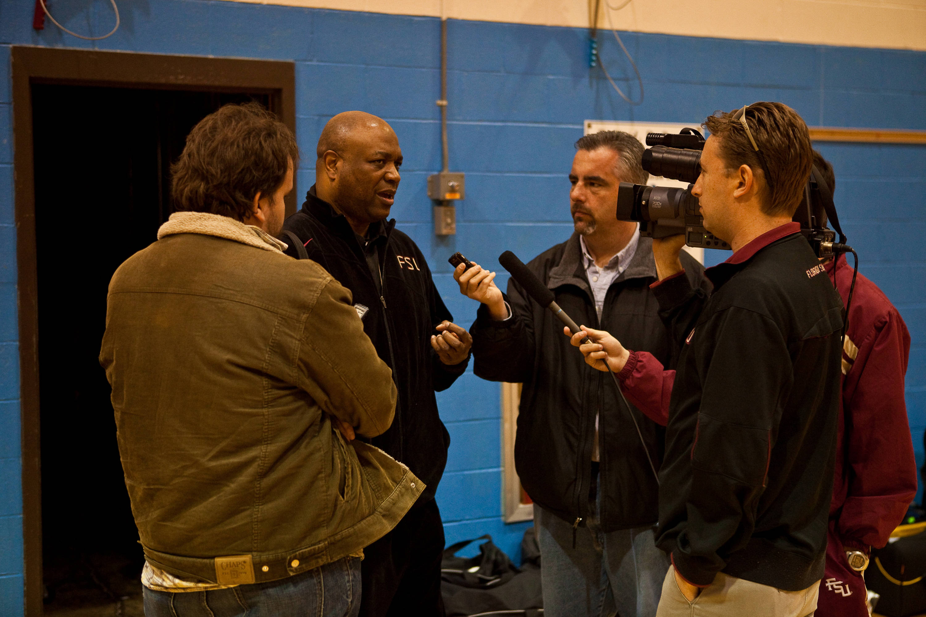 Coach Hamilton talks with some of the media outside FSU's locker room at the HSBC Arena.