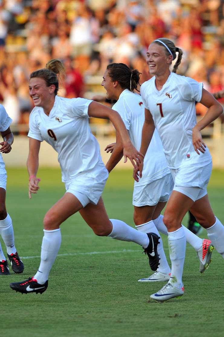 Kassey Kallman celebrates with her teammates after scoring what would be the eventual game-winner in the 10th minute of play against New Mexico.