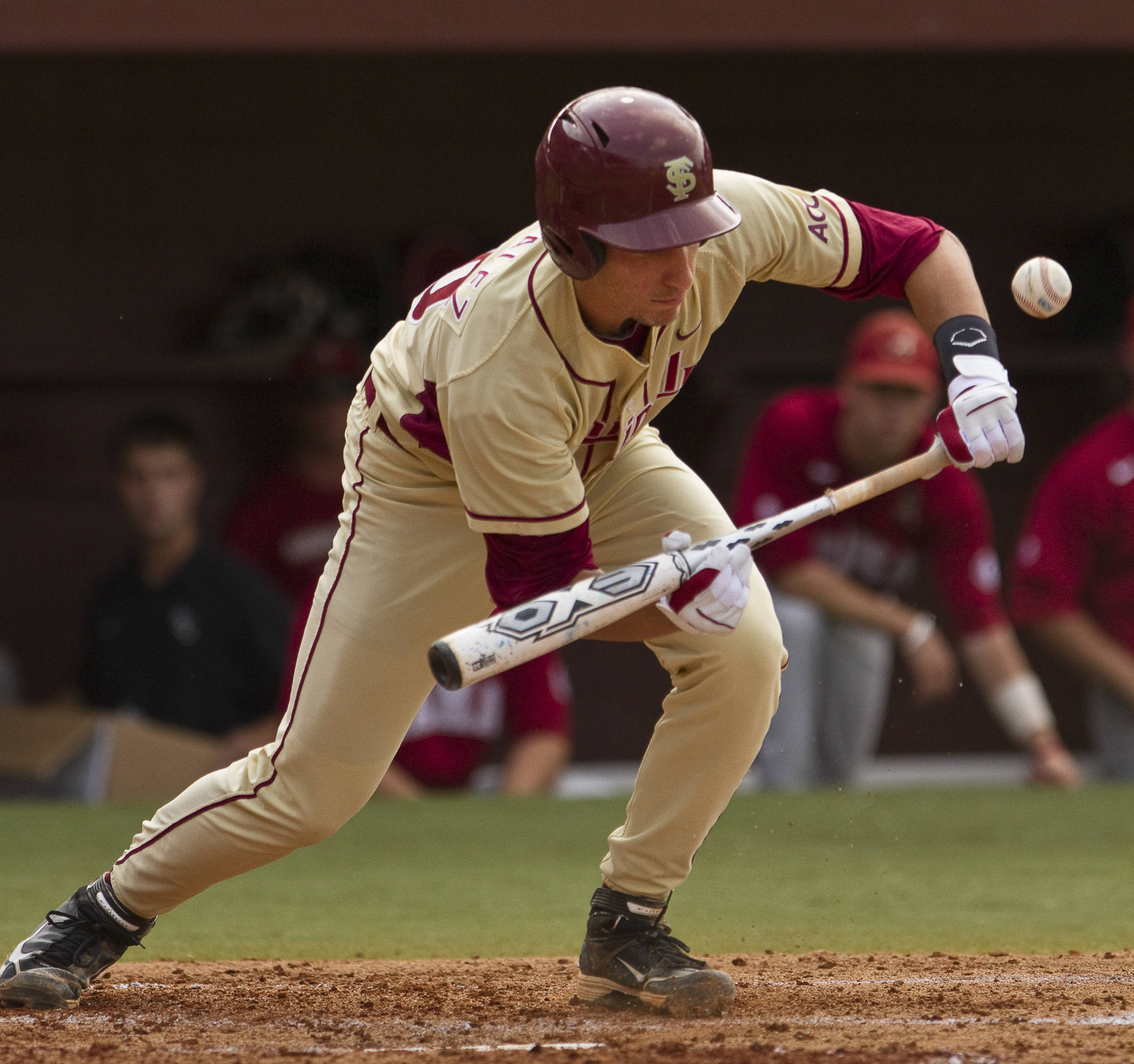 Justin Gonzalez (10) bunts during the second inning.