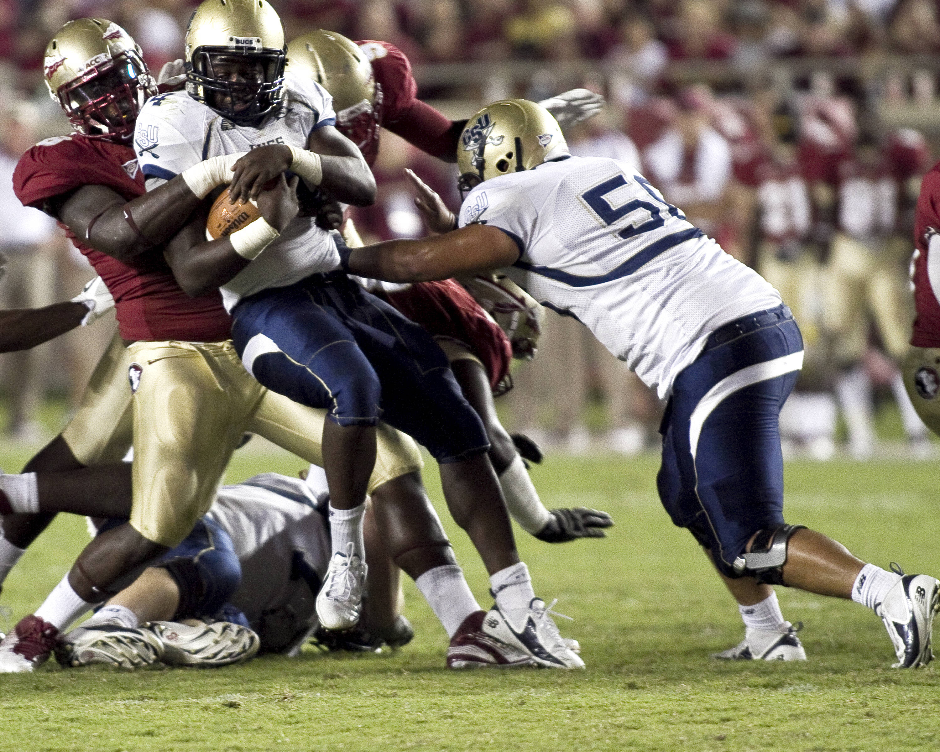 Defensive tackle Cameron Erving (98) with a tackle