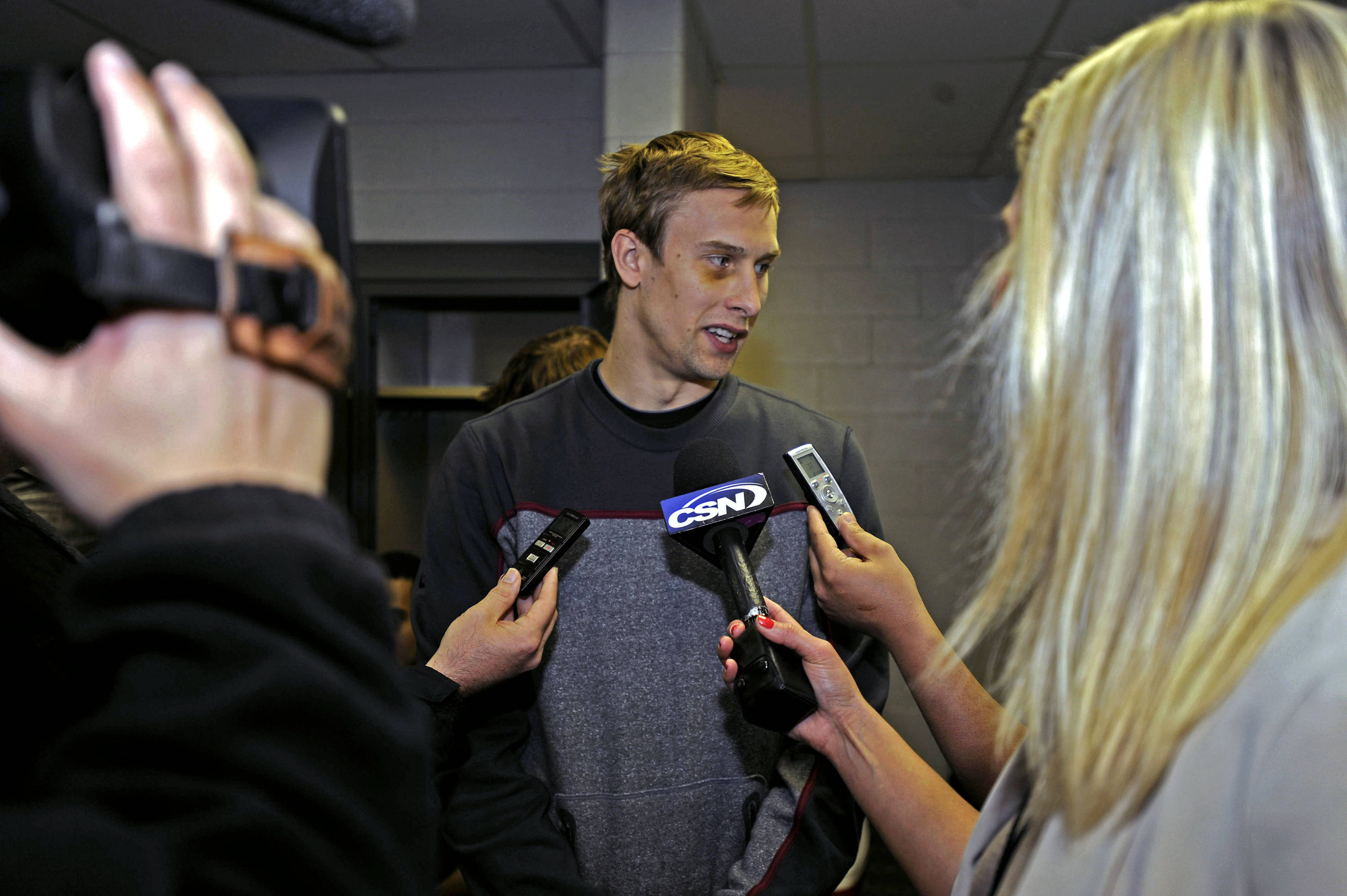 Deividas Dulkys answers questions in the locker room
