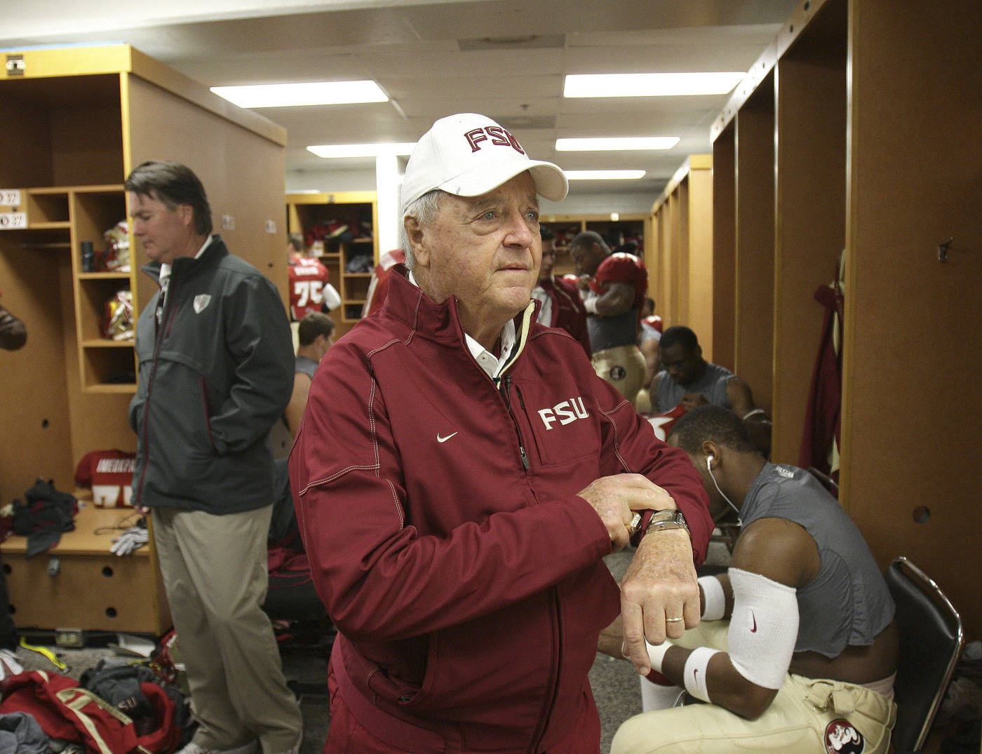 Florida State head coach Bobby Bowden checks his watch in the locker room as he prepares to go on to the field prior to the Gator Bowl NCAA college football game against West Virginia,  Friday, Jan. 1, 2010, in Jacksonville, Fla.(AP Photo/Phil Coale)