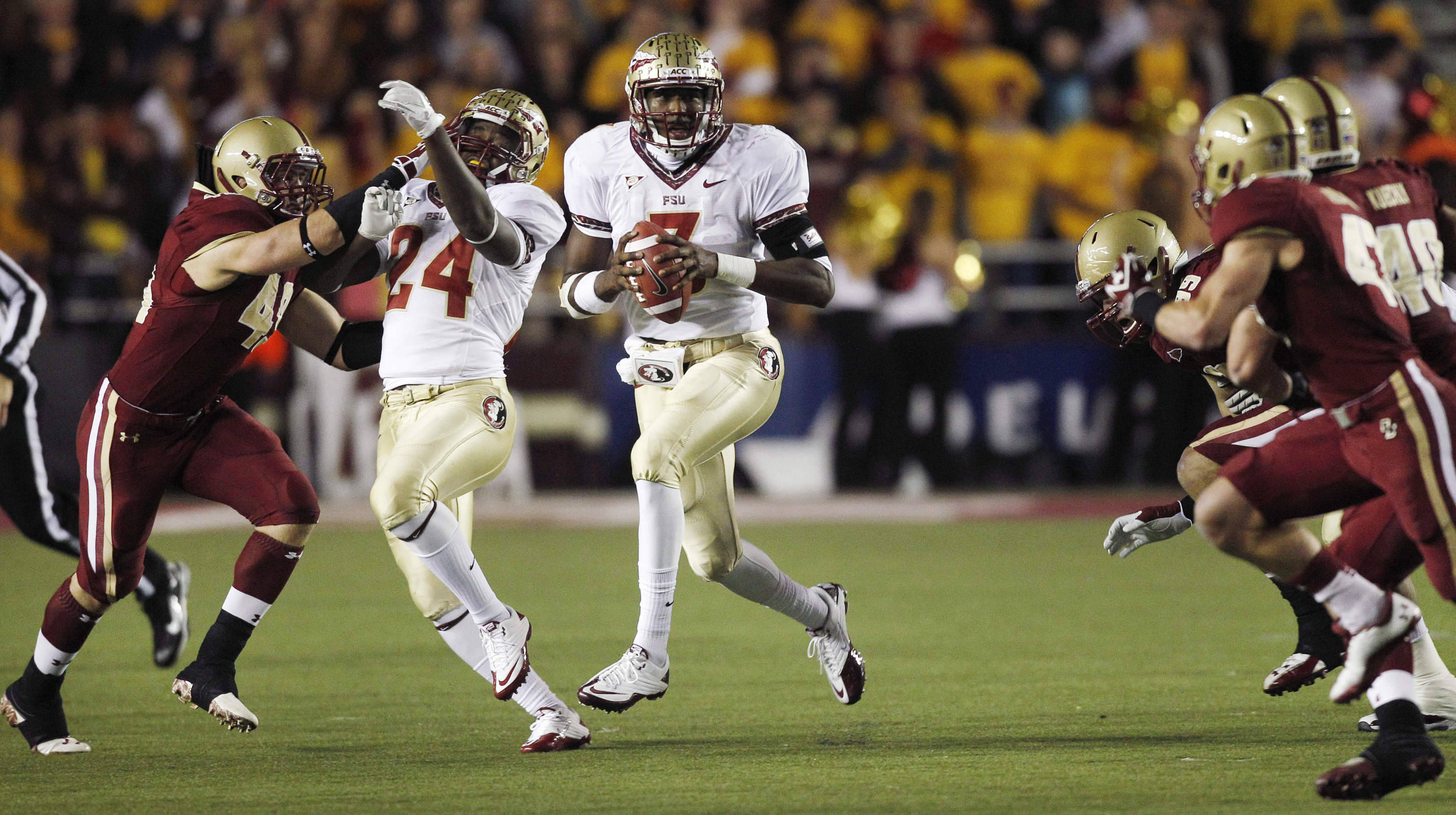 Florida State quarterback E.J. Manuel (3) scrambles through a hole in the Boston College defense for a gain during the first half. (AP Photo/Charles Krupa)