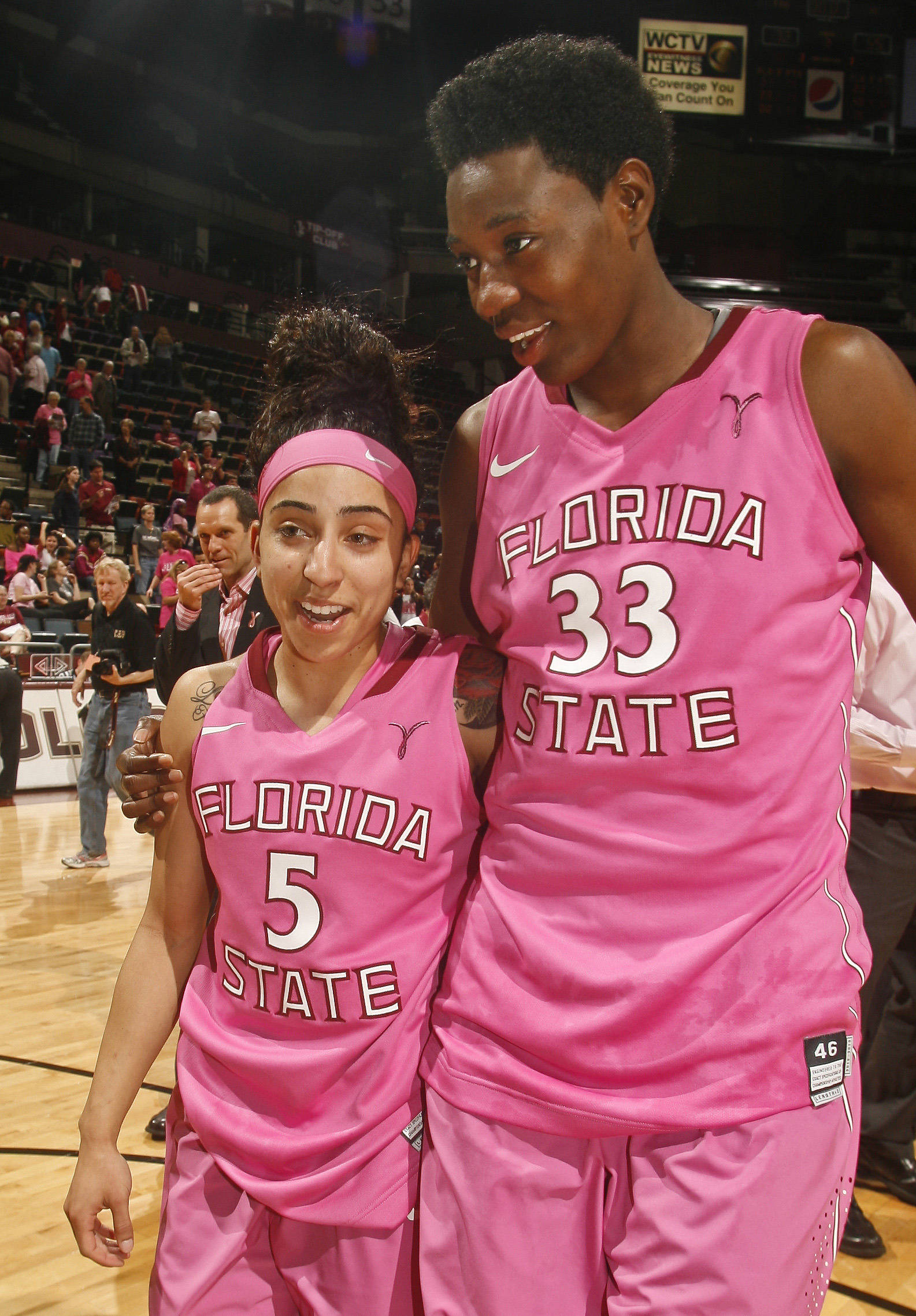 Florida State Seminoles guard Cheetah Delgado (5) celebrates with Natasha Howard (33) after setting a school record of 15 assists after the game against the Boston College Eagles. Mandatory Credit: Phil Sears-USA TODAY Sports