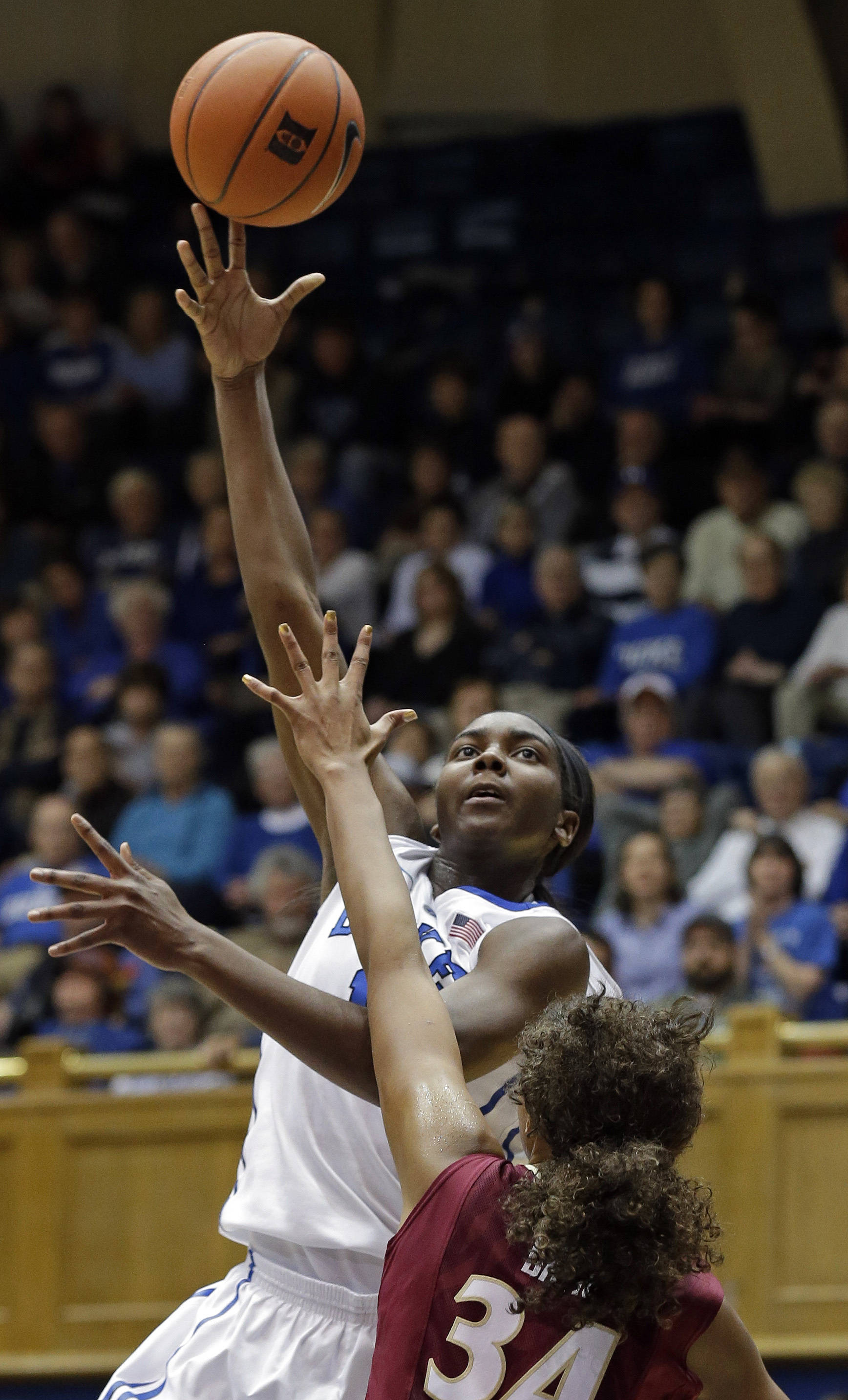 Duke's Elizabeth Williams shoots as Florida State's Chelsea Davis (34) defends. (AP Photo/Gerry Broome)