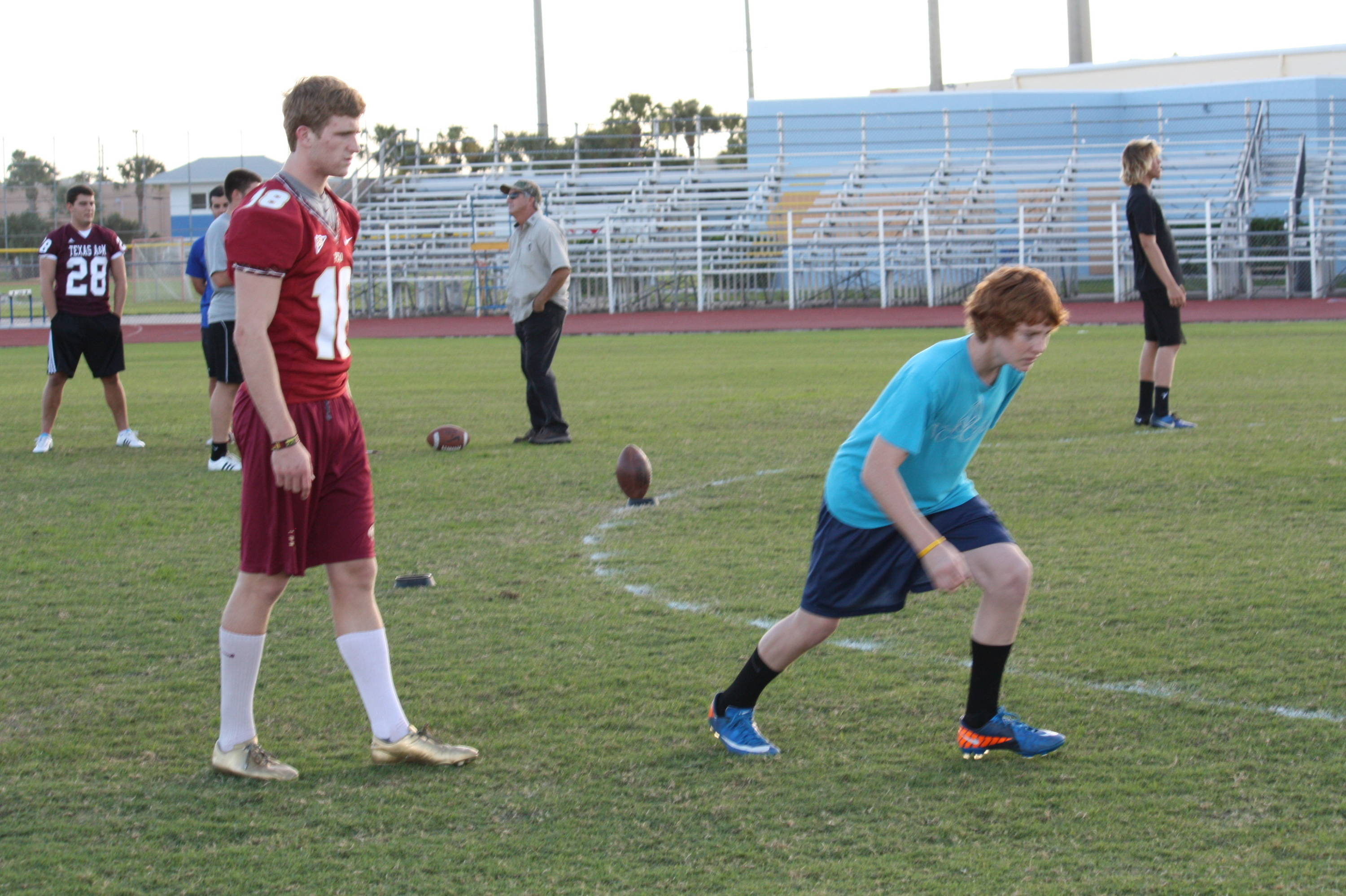 Dustin casts a watchful eye over a youngster working on his kickoff approach.