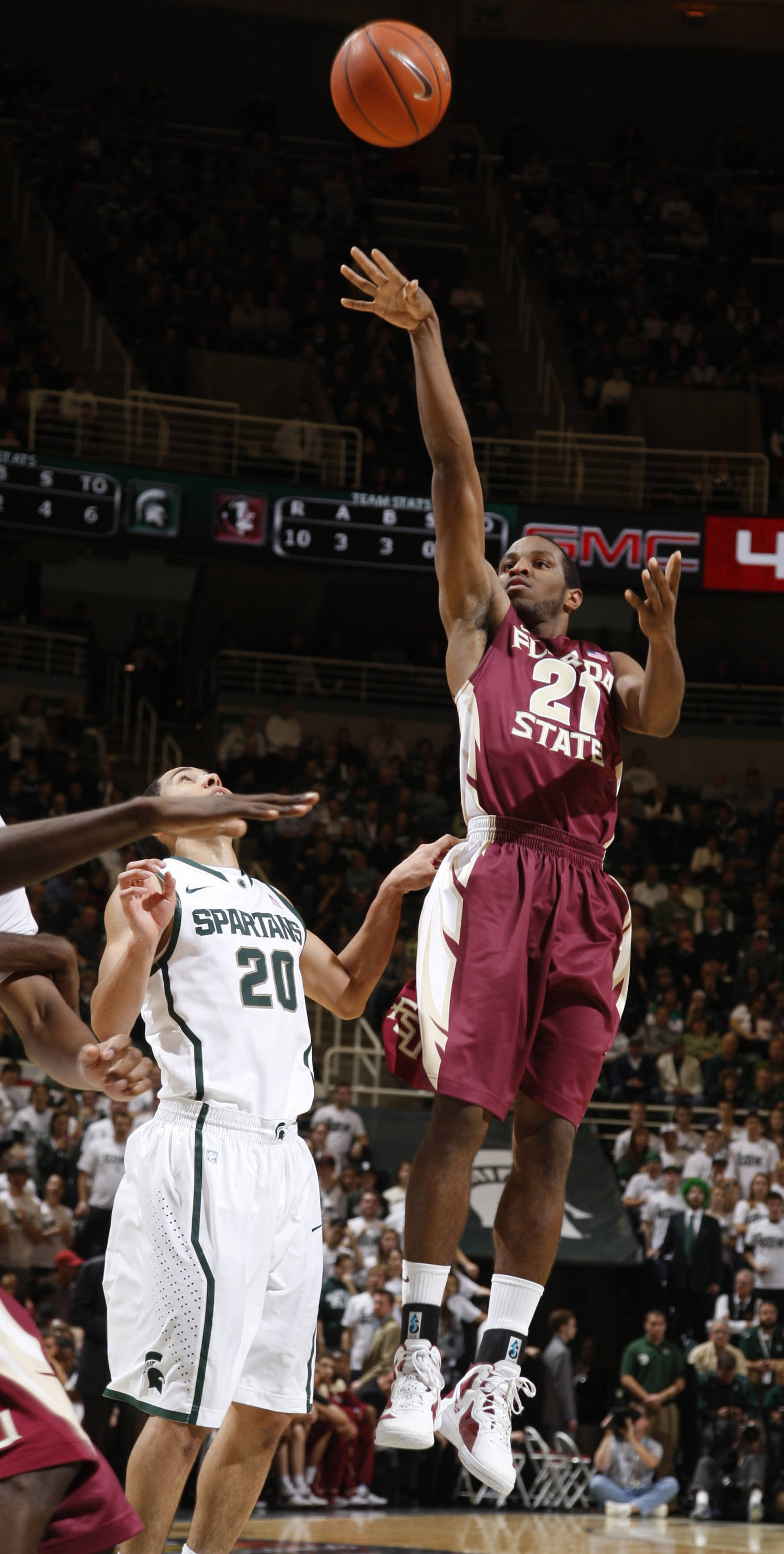 Florida State's Michael Snaer shoots over Michigan State's Travis Trice  during the first half. (AP Photo/Al Goldis)