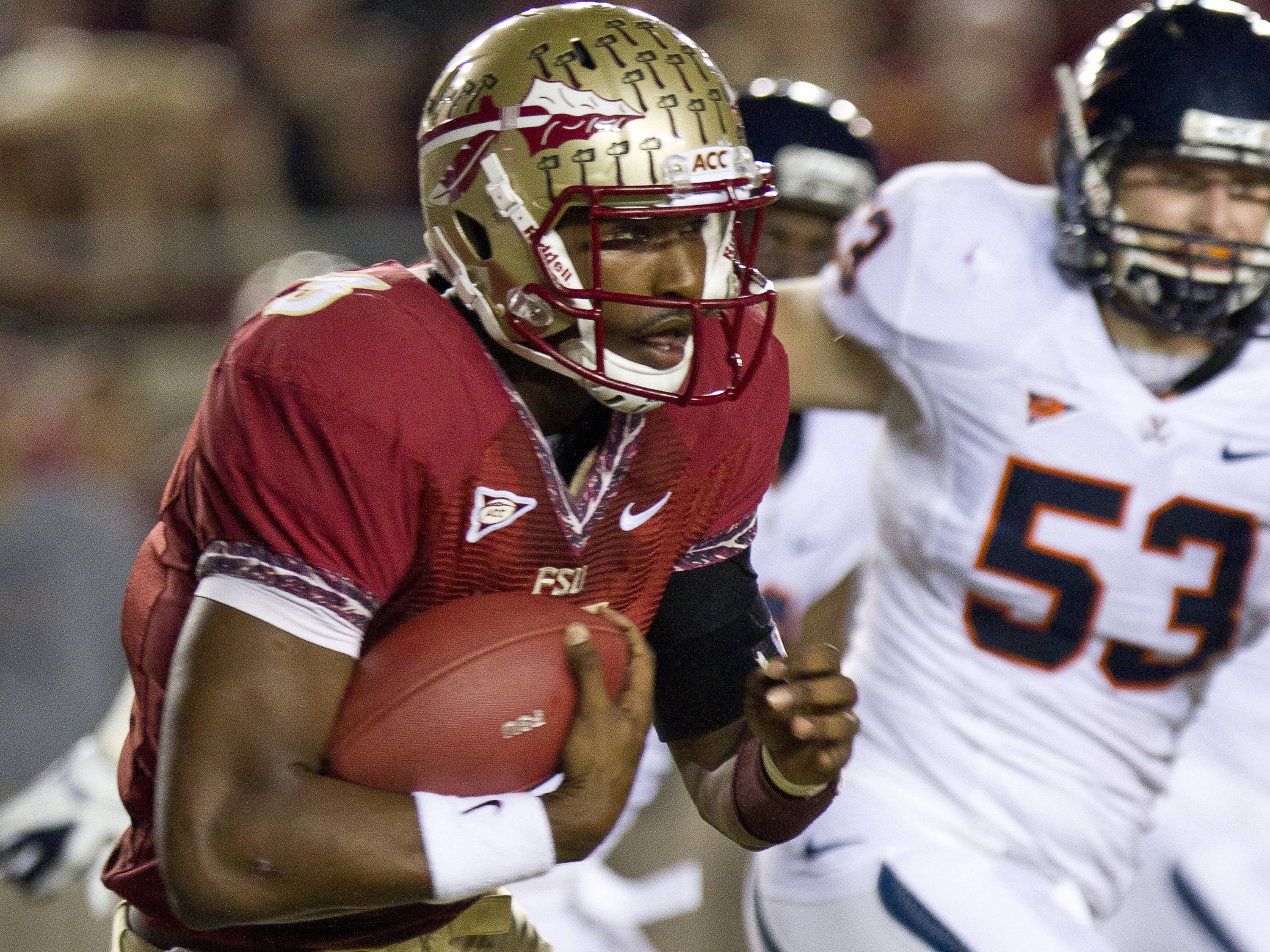 EJ Manuel (3) carries the ball up the field during the game against Virginia on November 19, 2011.
