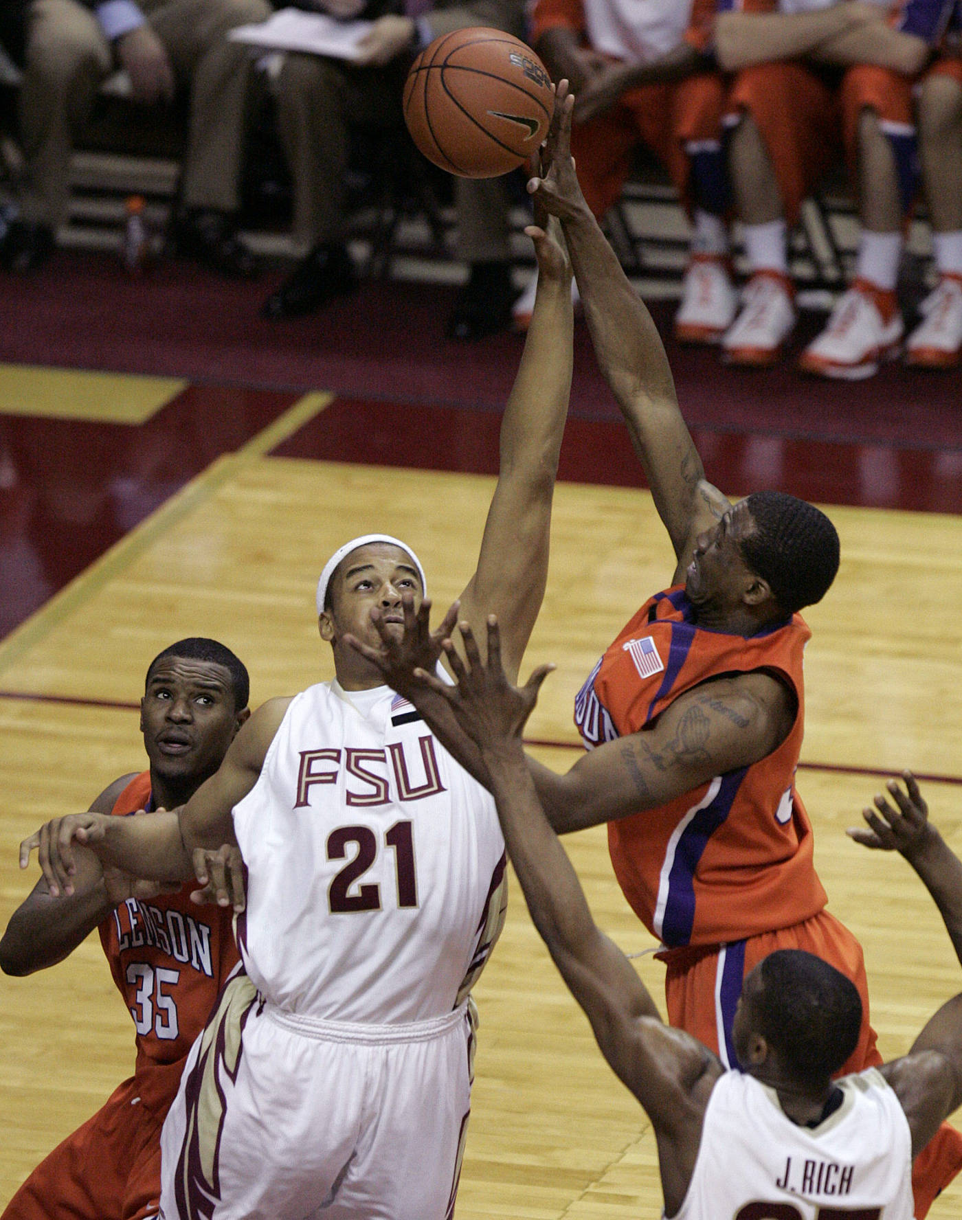 Clemson's Trevor Booker gets a shot off against Florida State's Julian Vaughn in the second half of a basketball game which the Seminoles won 64-55 on Tuesday, Feb. 19, 2008, in Tallahassee, Fla. (AP Photo/Steve Cannon)