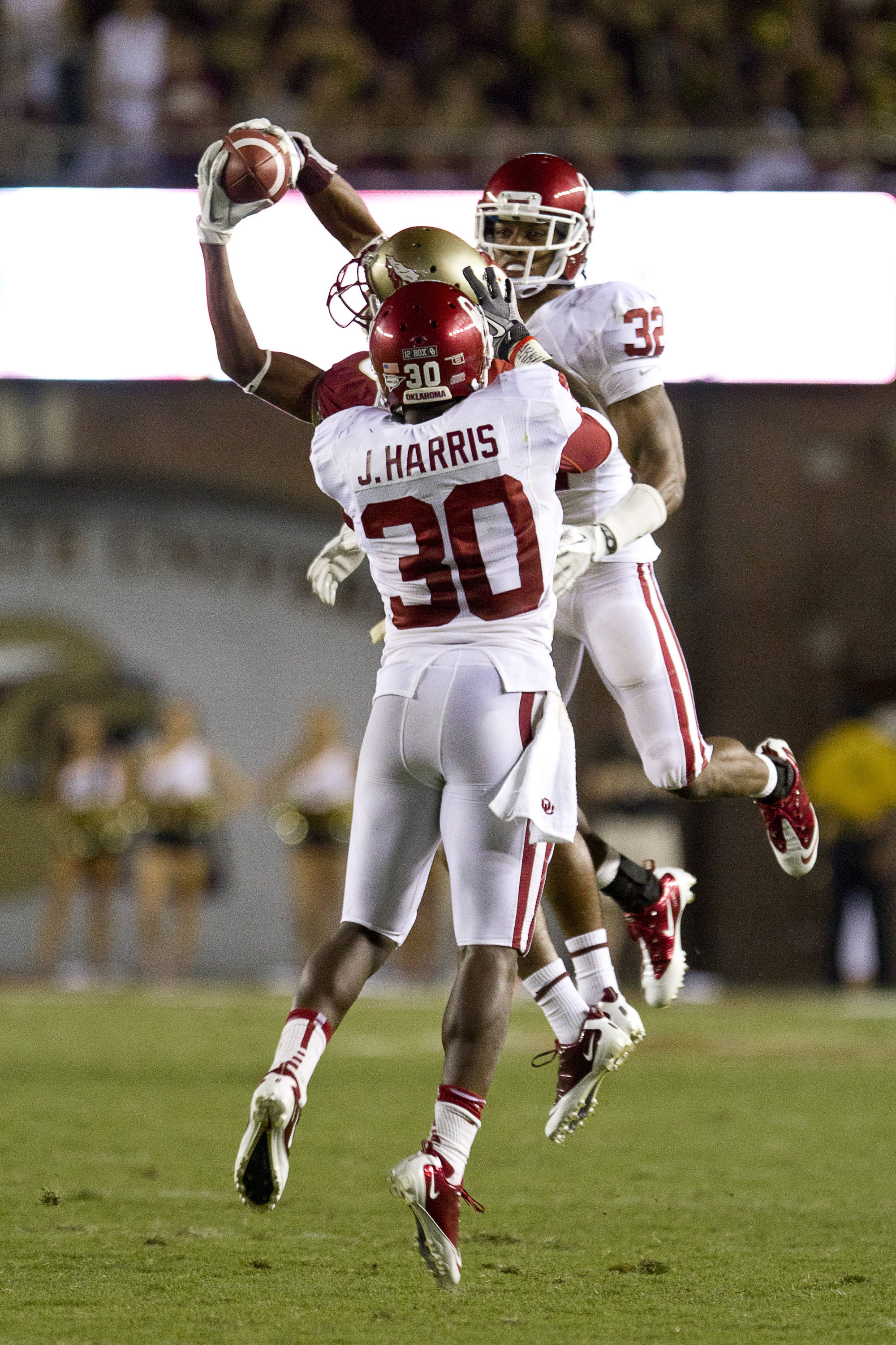 Rashad Greene (80), flanked by two defenders, catches a pass and runs it in for a touchdown during the game against Oklahoma on September 17, 2011.